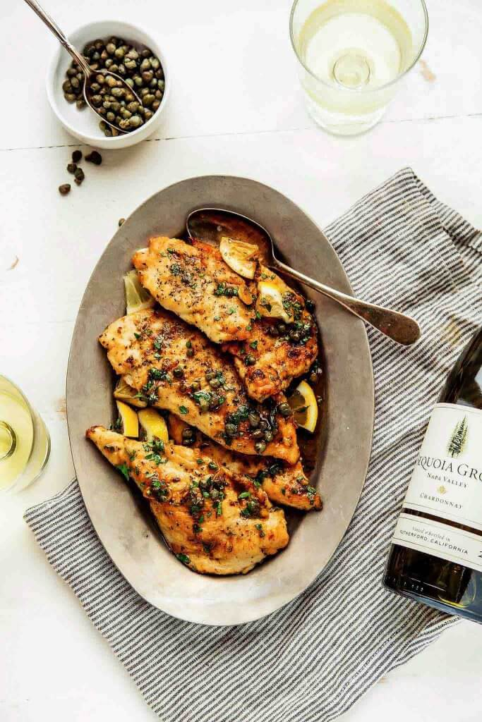 30 Minute Easy Chicken Piccata is perfect for a quick weeknight dinner. The lemon-garlic, butter caper sauce will have you licking your plate.   platingsandpairings.com