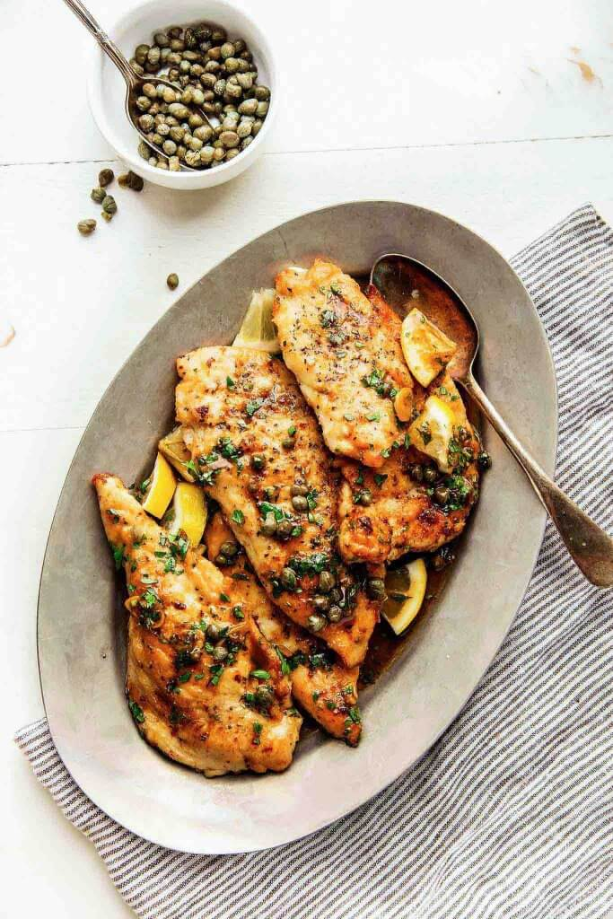 30 Minute Easy Chicken Piccata is perfect for a quick weeknight dinner. The lemon-garlic, butter caper sauce will have you licking your plate. | platingsandpairings.com