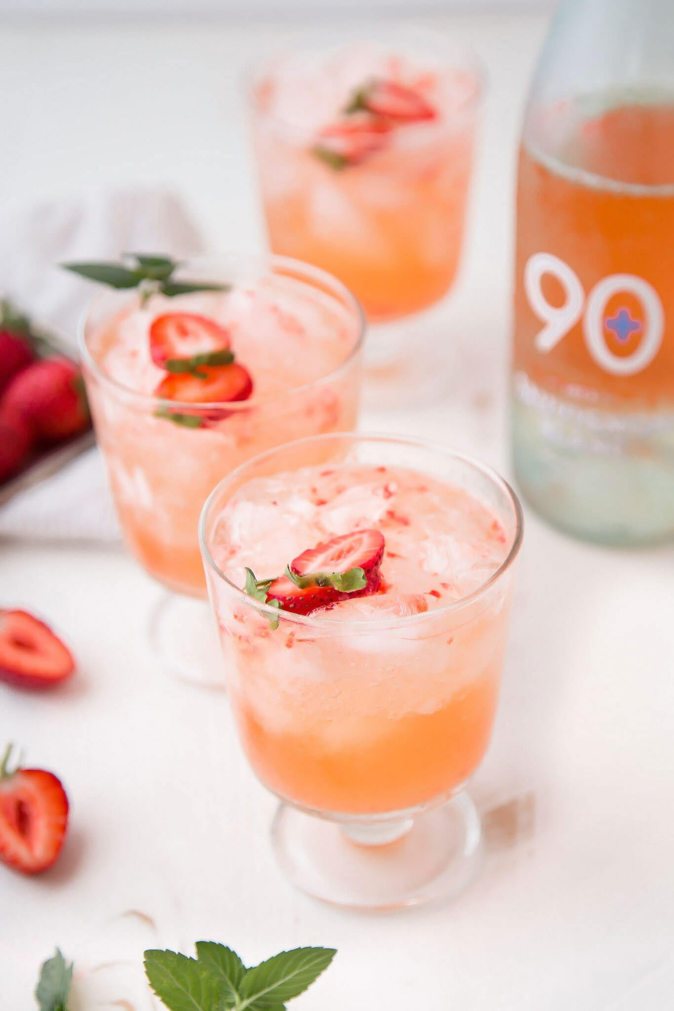 This Strawberry Sauvignon Blanc Cocktail combines wine, vodka, fresh strawberries & soda water for a thirst quenching cocktail that's perfect for summer!