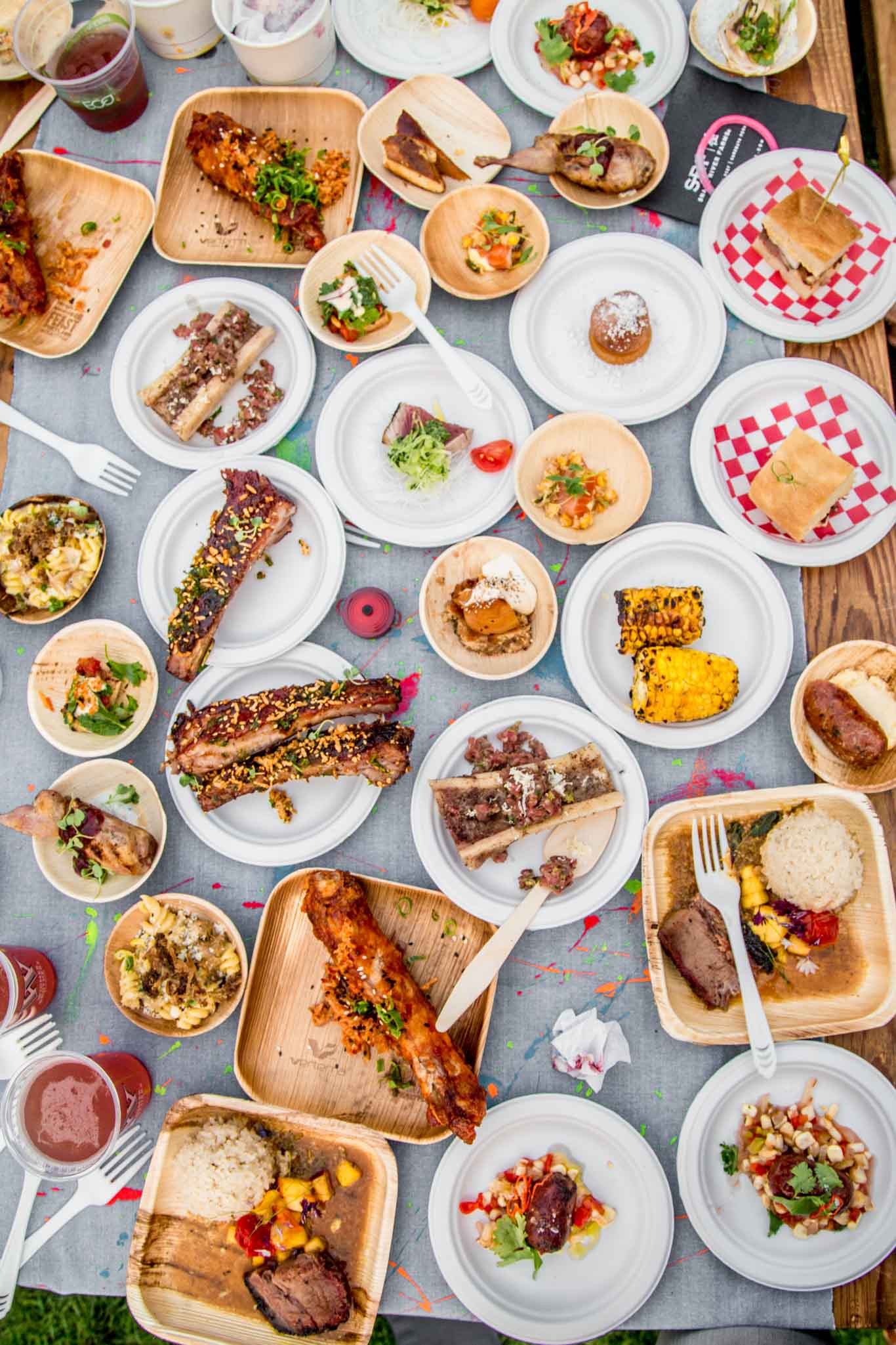 FEAST Portland - Overhead shot of table filled with lots of small plates of food.