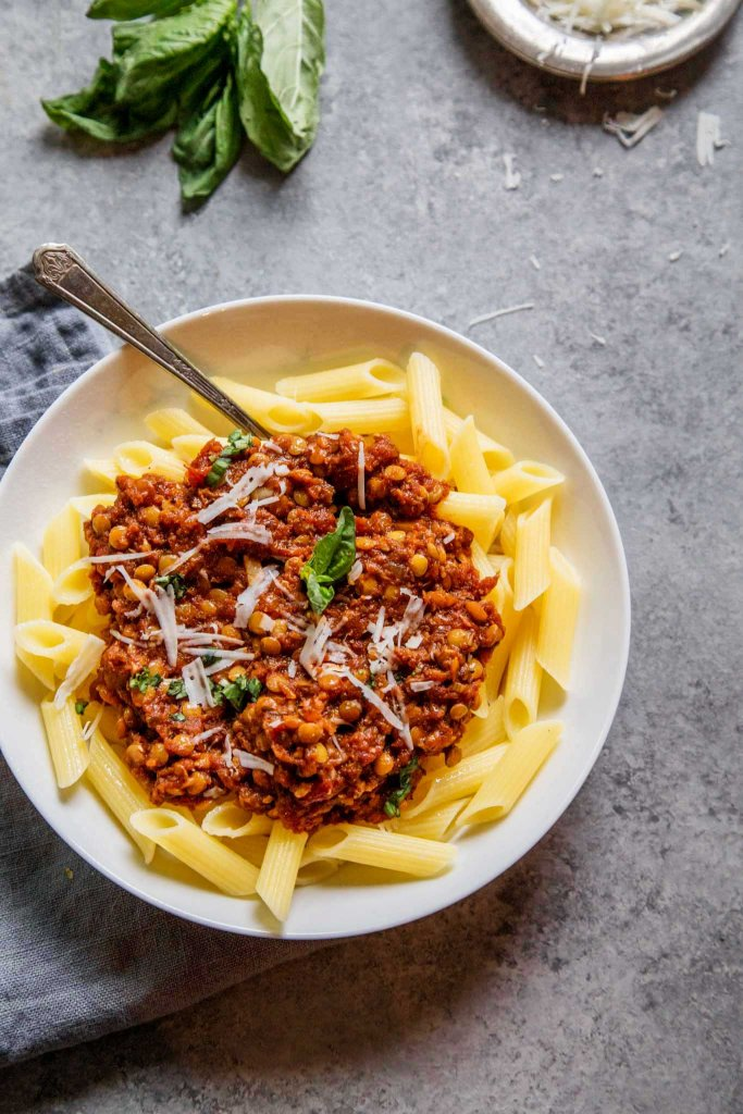 Instant Pot Lentil Bolognese Sauce can be made in no time with the help of your electric pressure cooker. It's vegetarian and packed with protein & fiber.