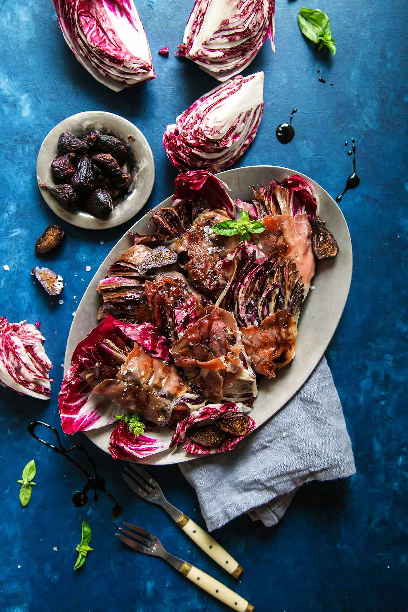 Up close platter of grilled radicchio with balsamic glaze.