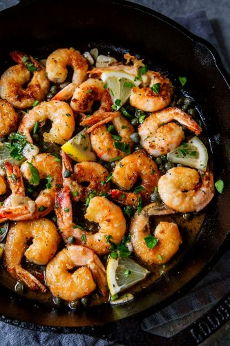 30-Minute Easy Shrimp Piccata makes a delicious appetizer, or serve the piccata over pasta for dinner. Shrimp are tossed in a lemon, garlic, butter sauce flecked with capers.