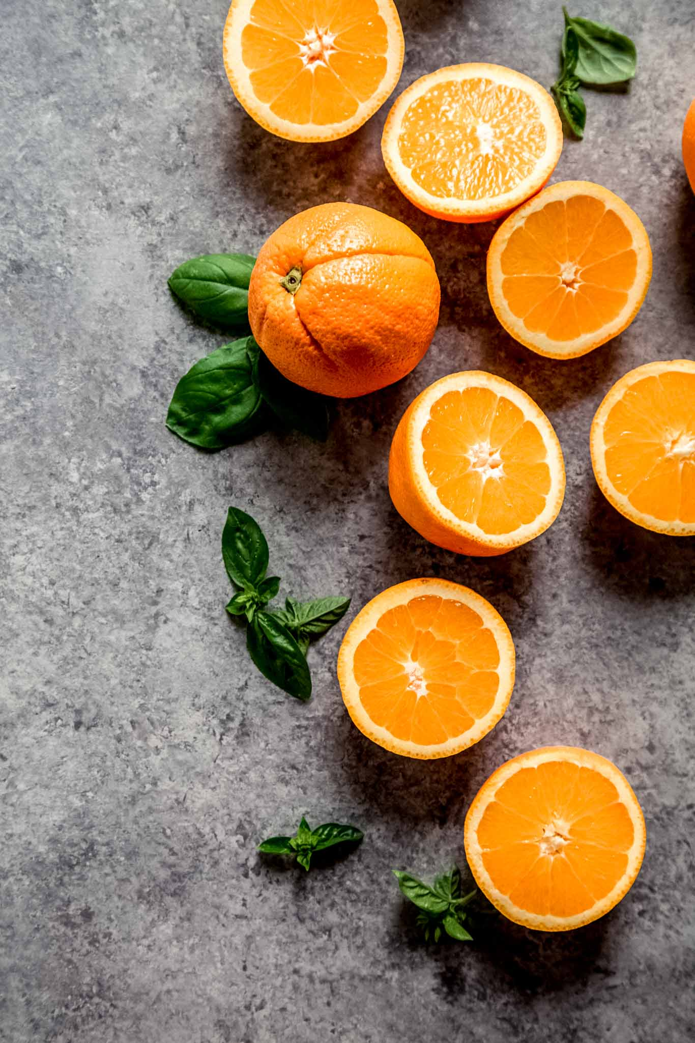 Oranges on concrete counter.