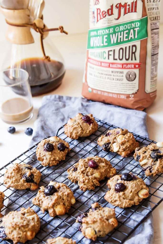 View of quinoa breakfast cookies with coffee in background.