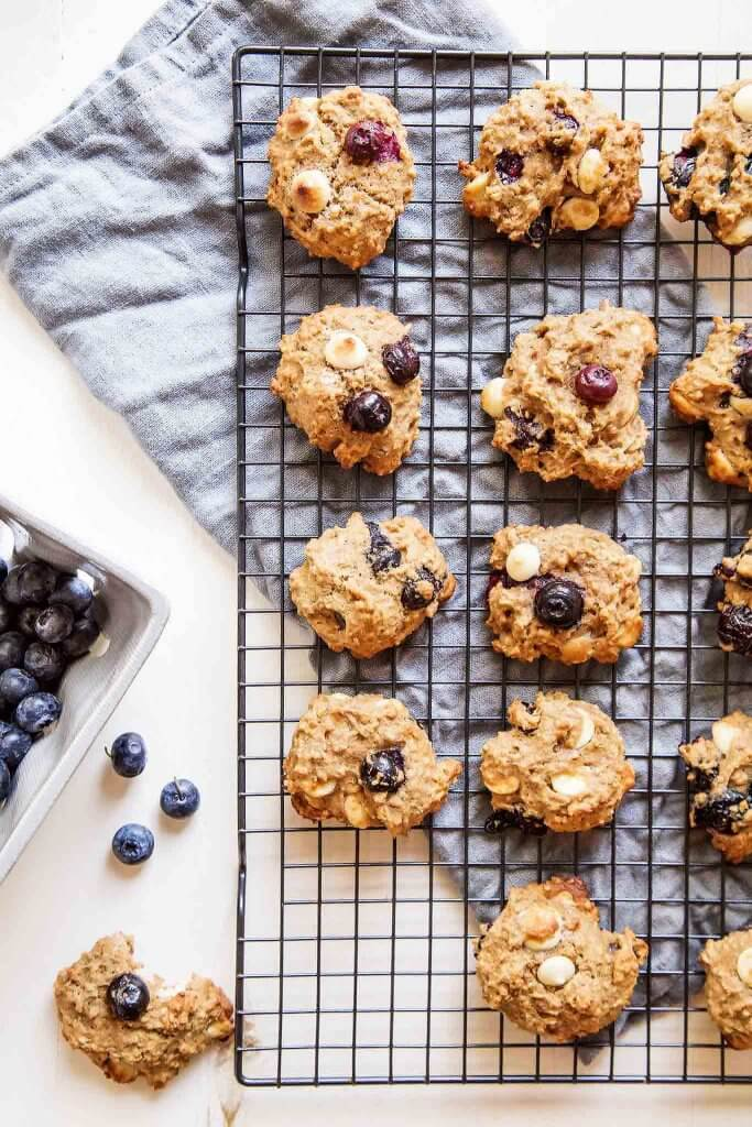 Close up of quinoa breakfast cookies, one with bite taken