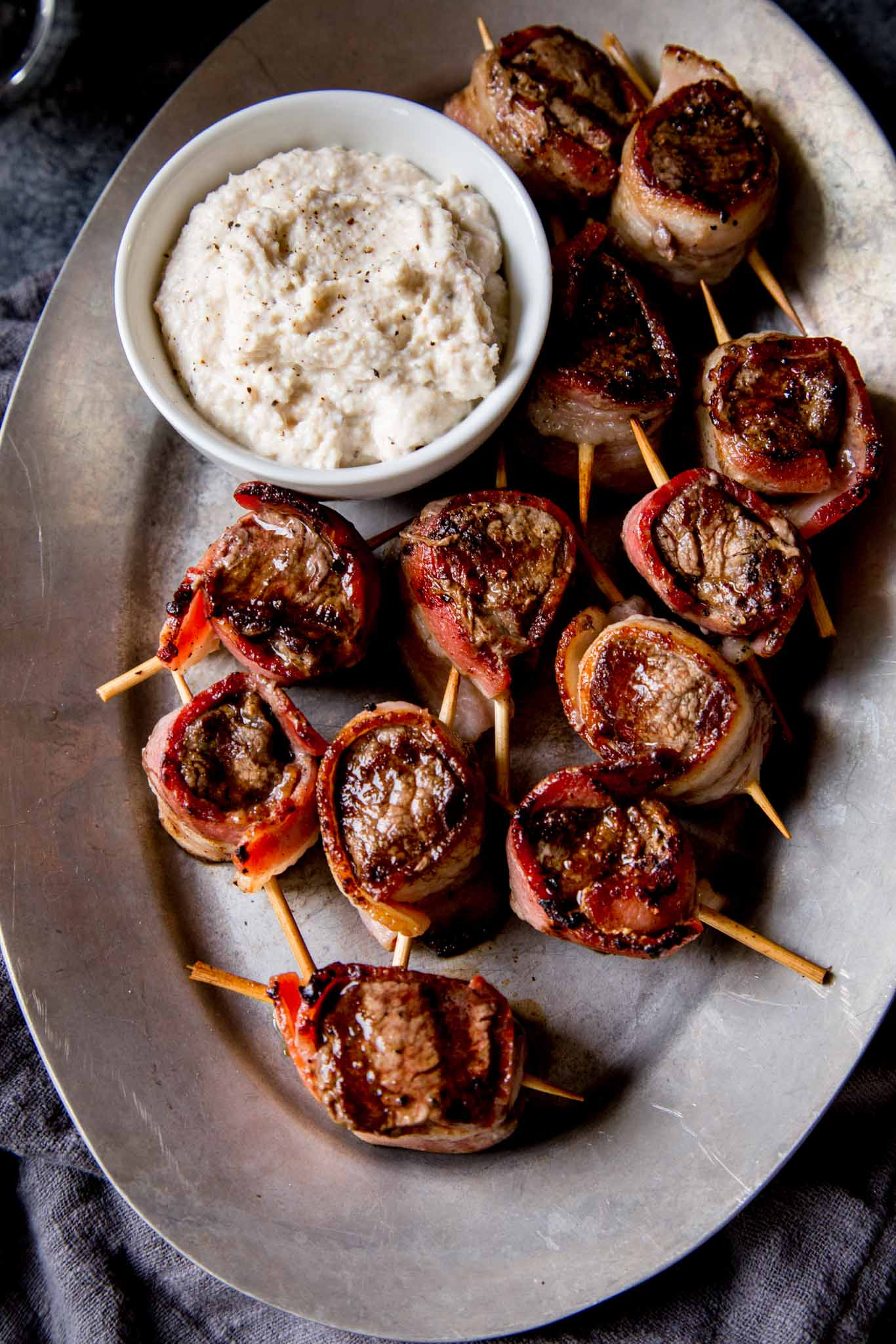 filet mignon bites on platter with creamy horseradish