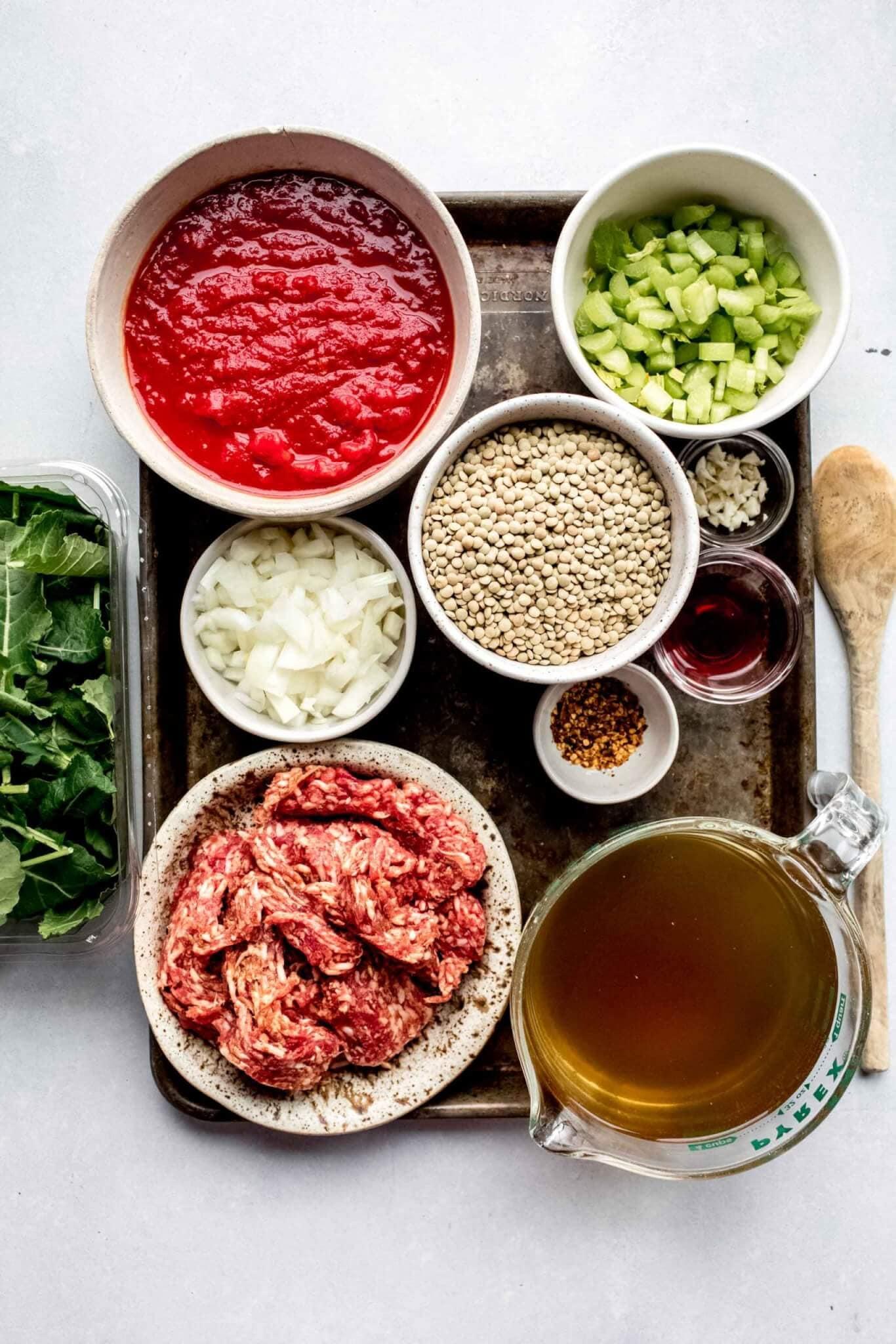 Ingredients for lentil soup on tray.