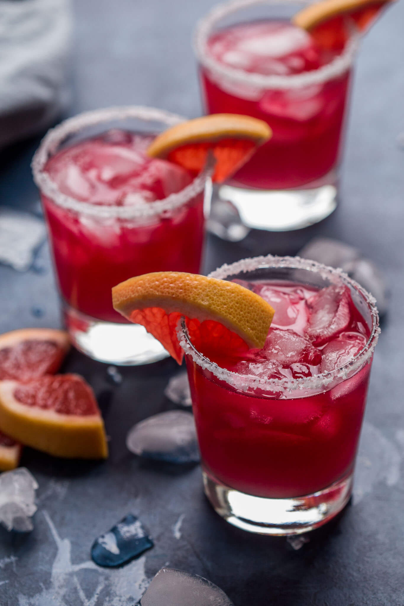 Hibiscus tea margaritas with wedges of grapefruit.