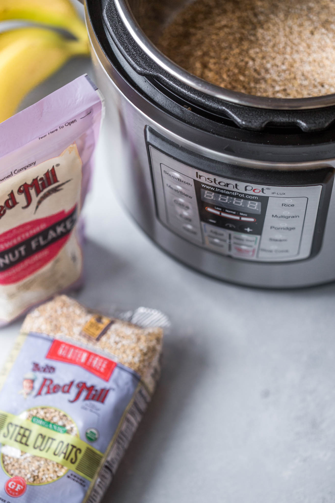 Instant Pot Steel Cut Oatmeal ingredients next to Instant Pot