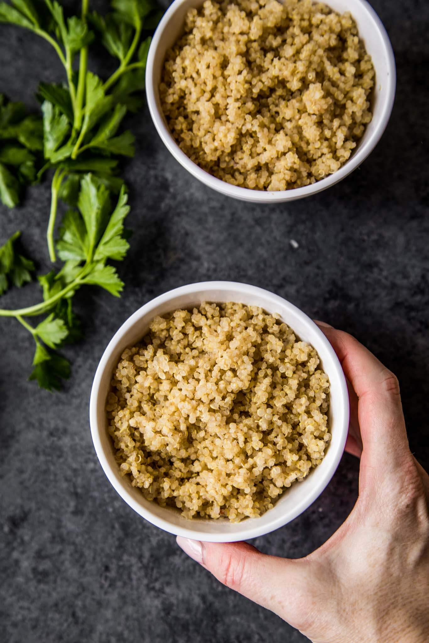 Hand reaching for Quinoa
