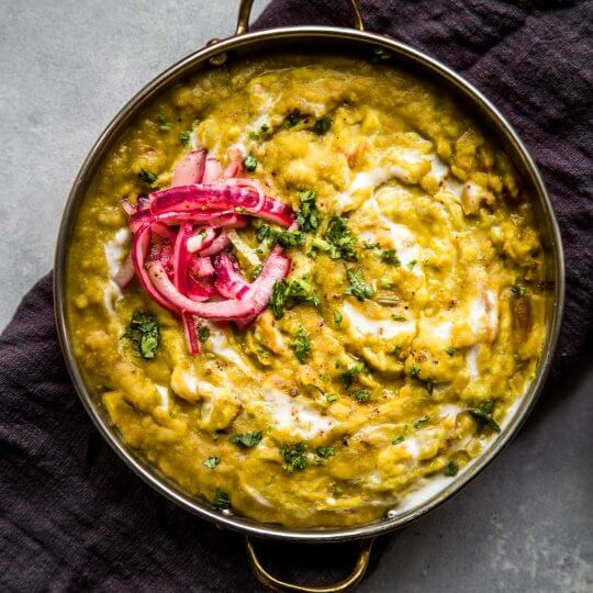 Overhead closeup view of split pea dal with pickled red onions