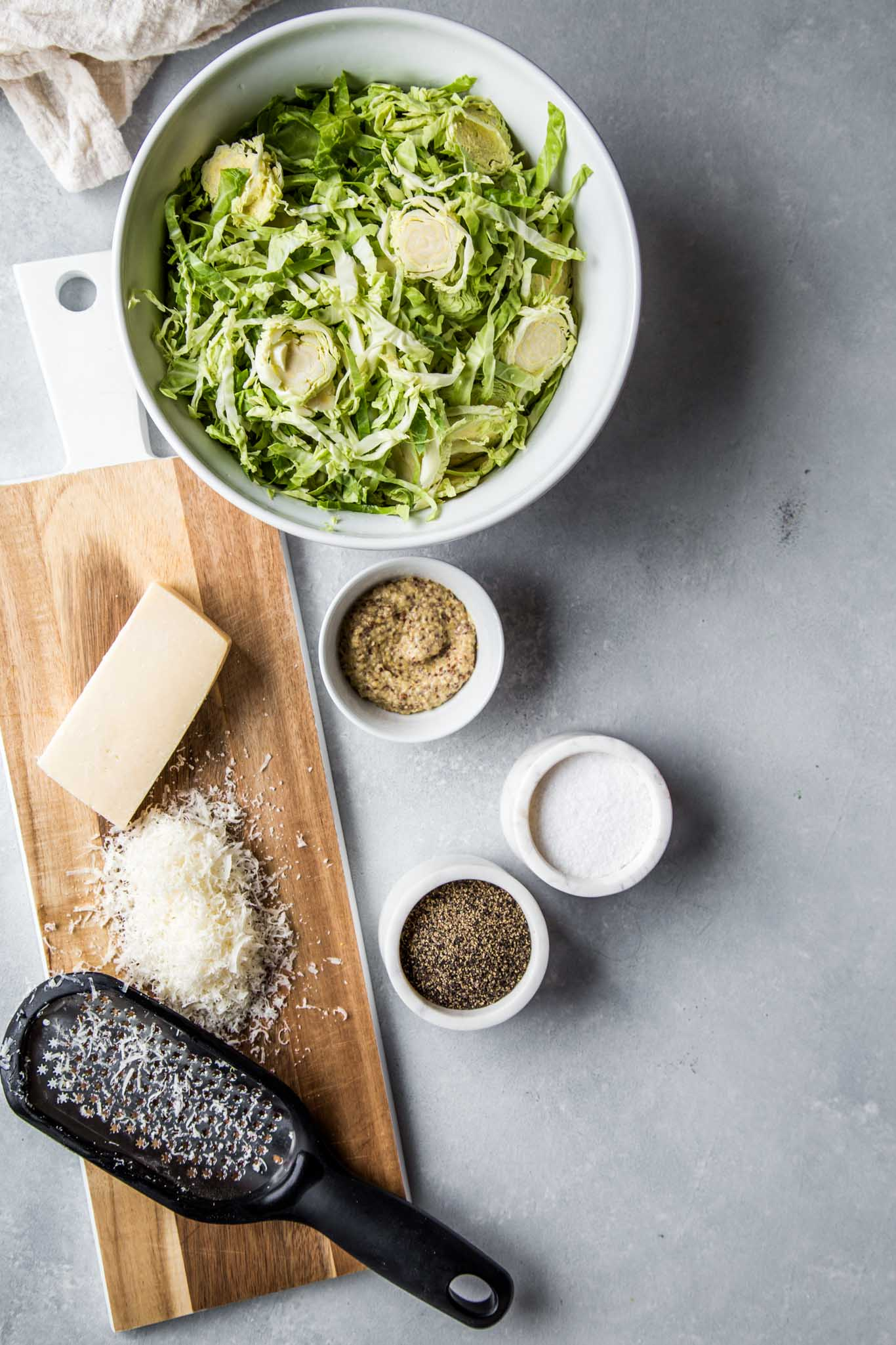 Ingredients for shaved brussels sprouts salad with mustard and parmesan