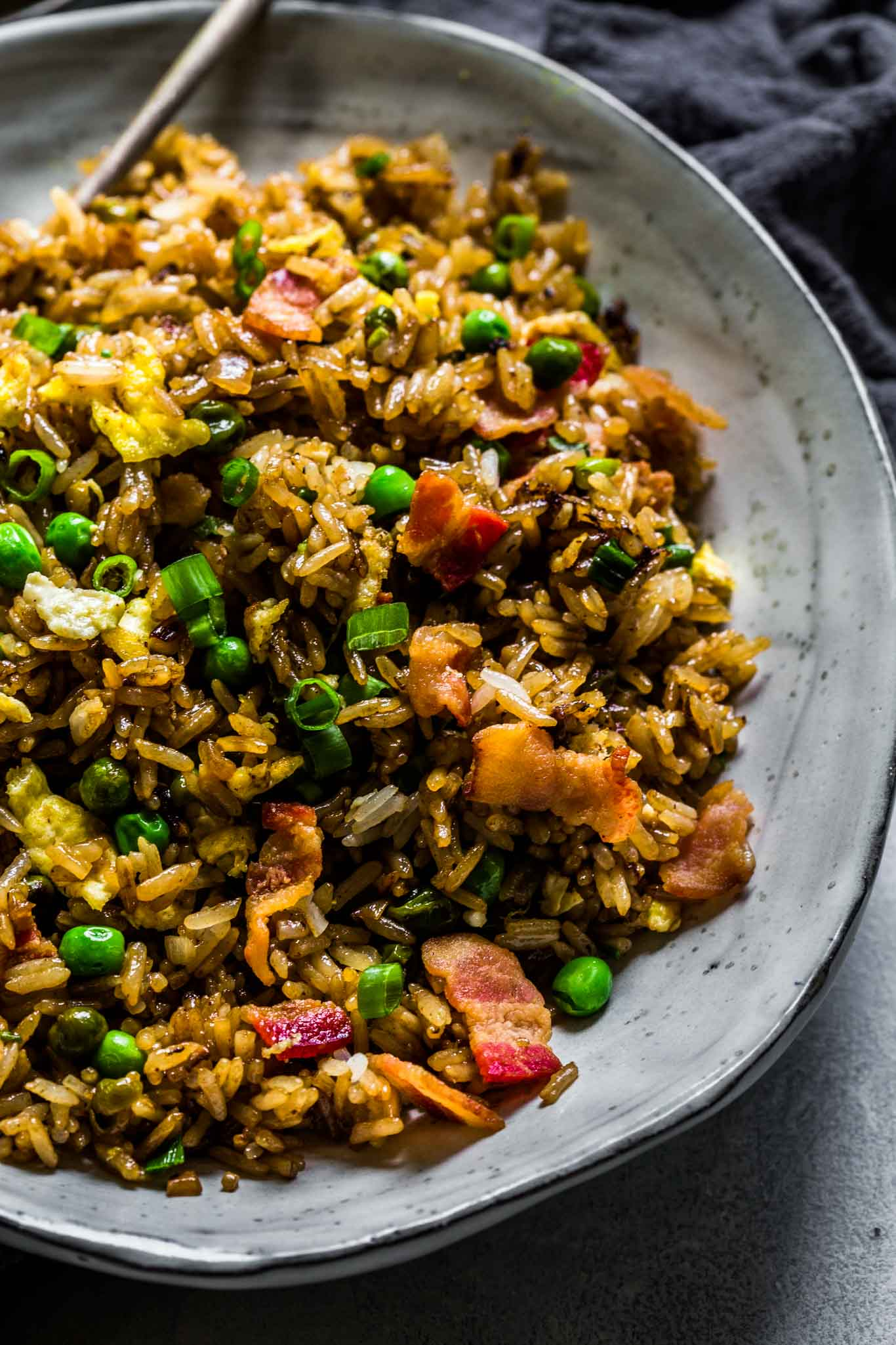 Bacon fried rice in large bowl.