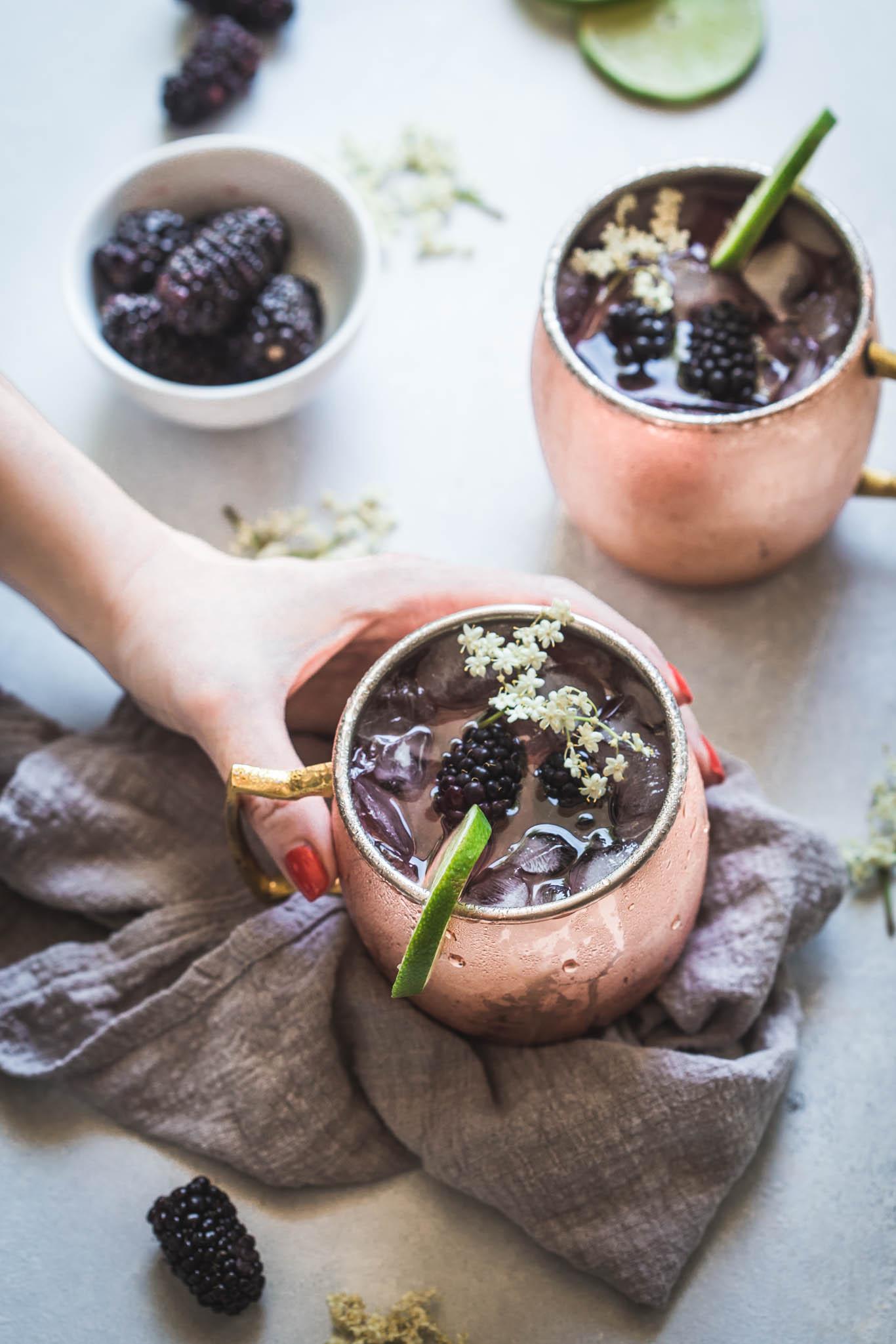 Hand holding copper mug