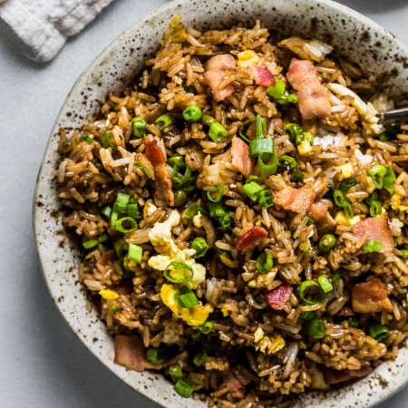 Fried rice in speckled bowl.