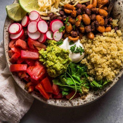 Overhead shot of quinoa taco bowls with quacamole.