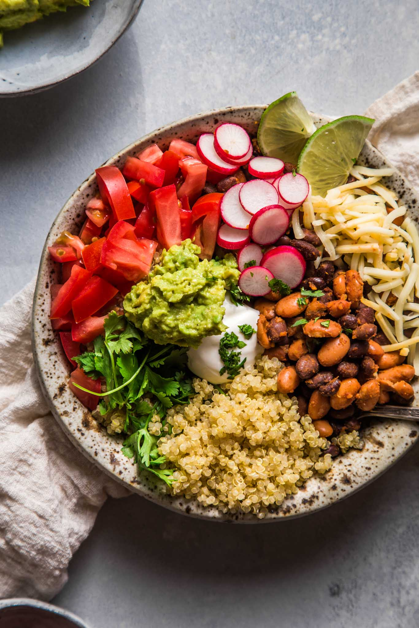 Close up overhead shot of quinoa taco bowl.