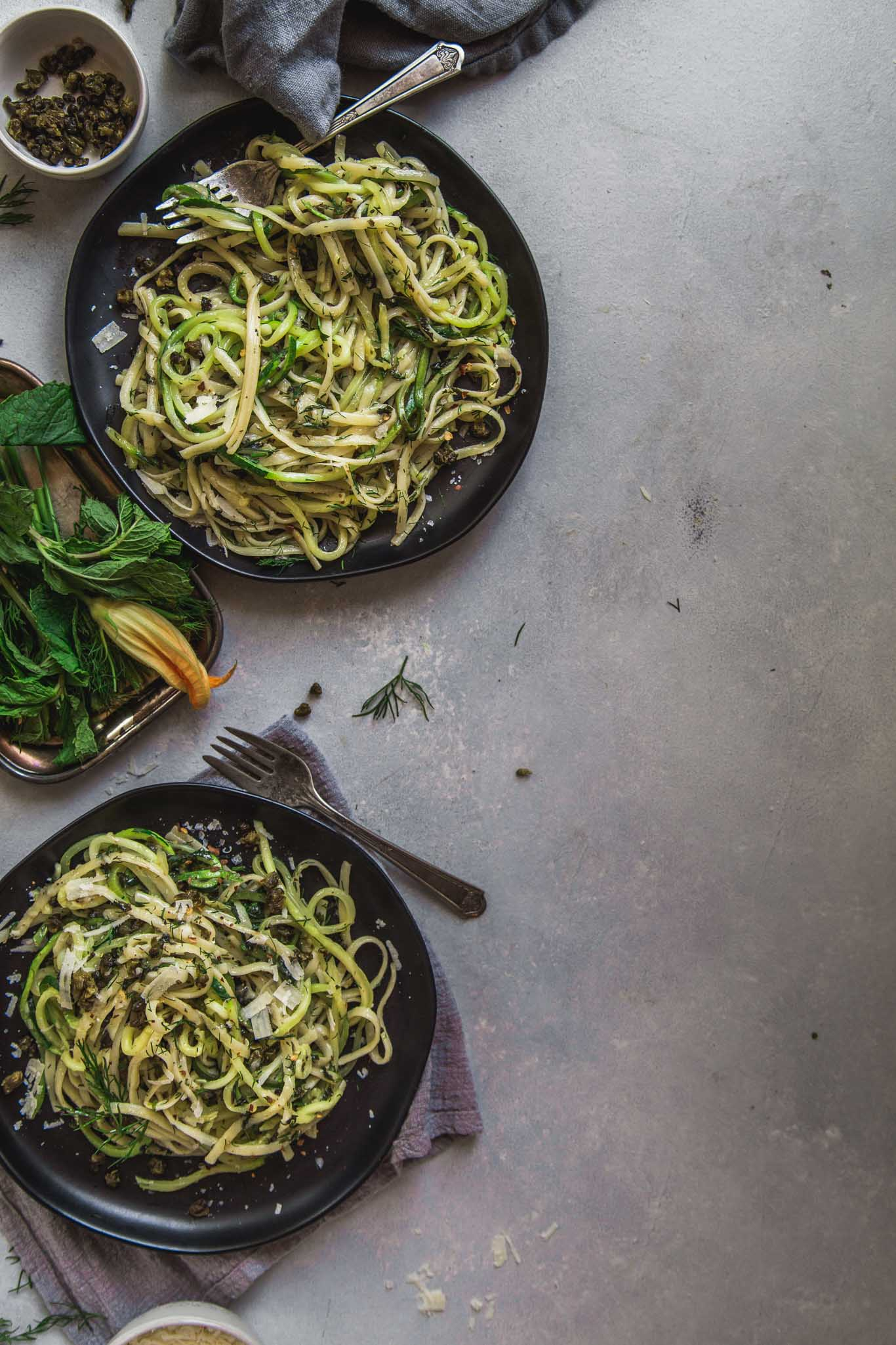 Two plates of zucchini noodles