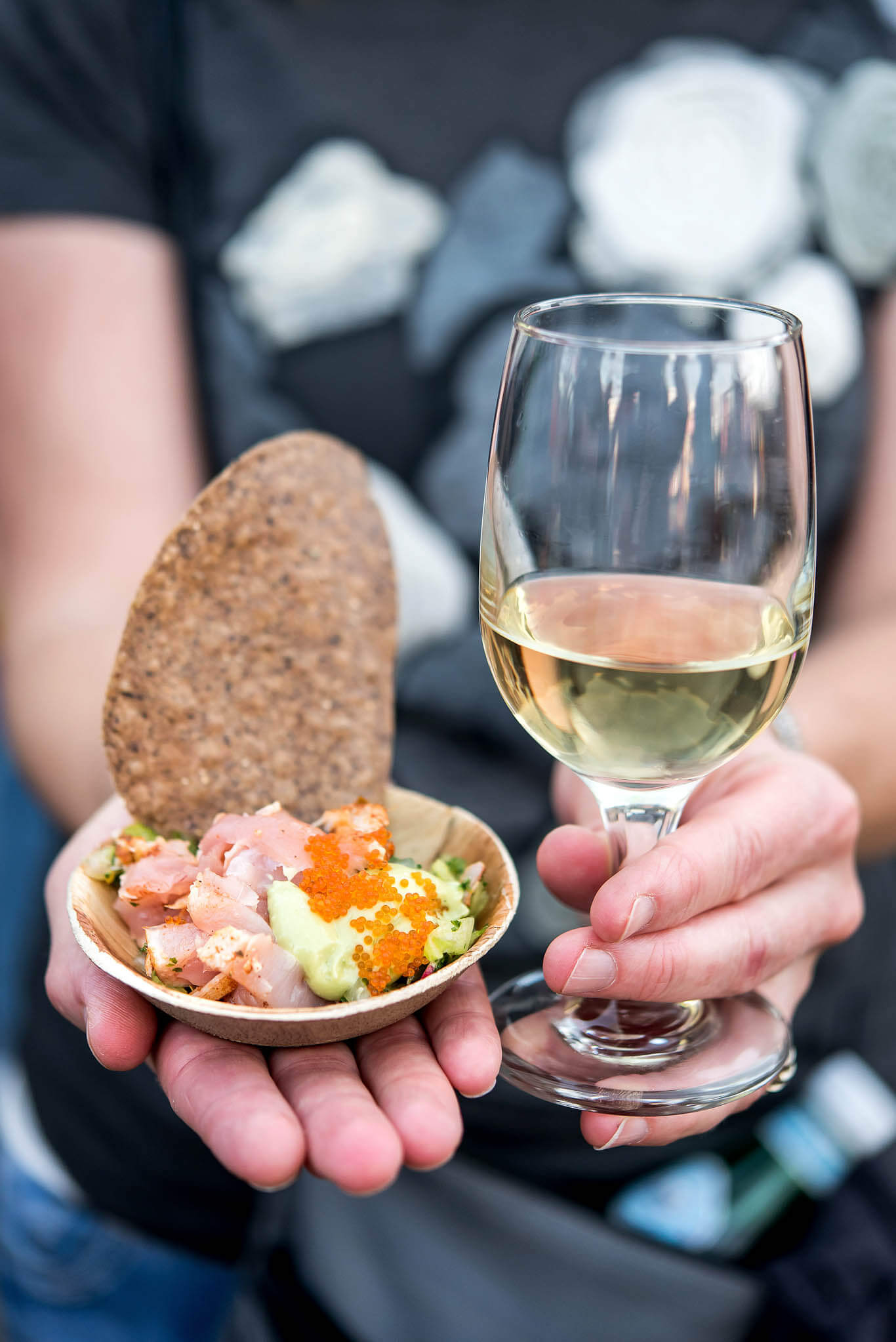 FEAST Portland - Hands holding glass of wine and small bite of ceviche