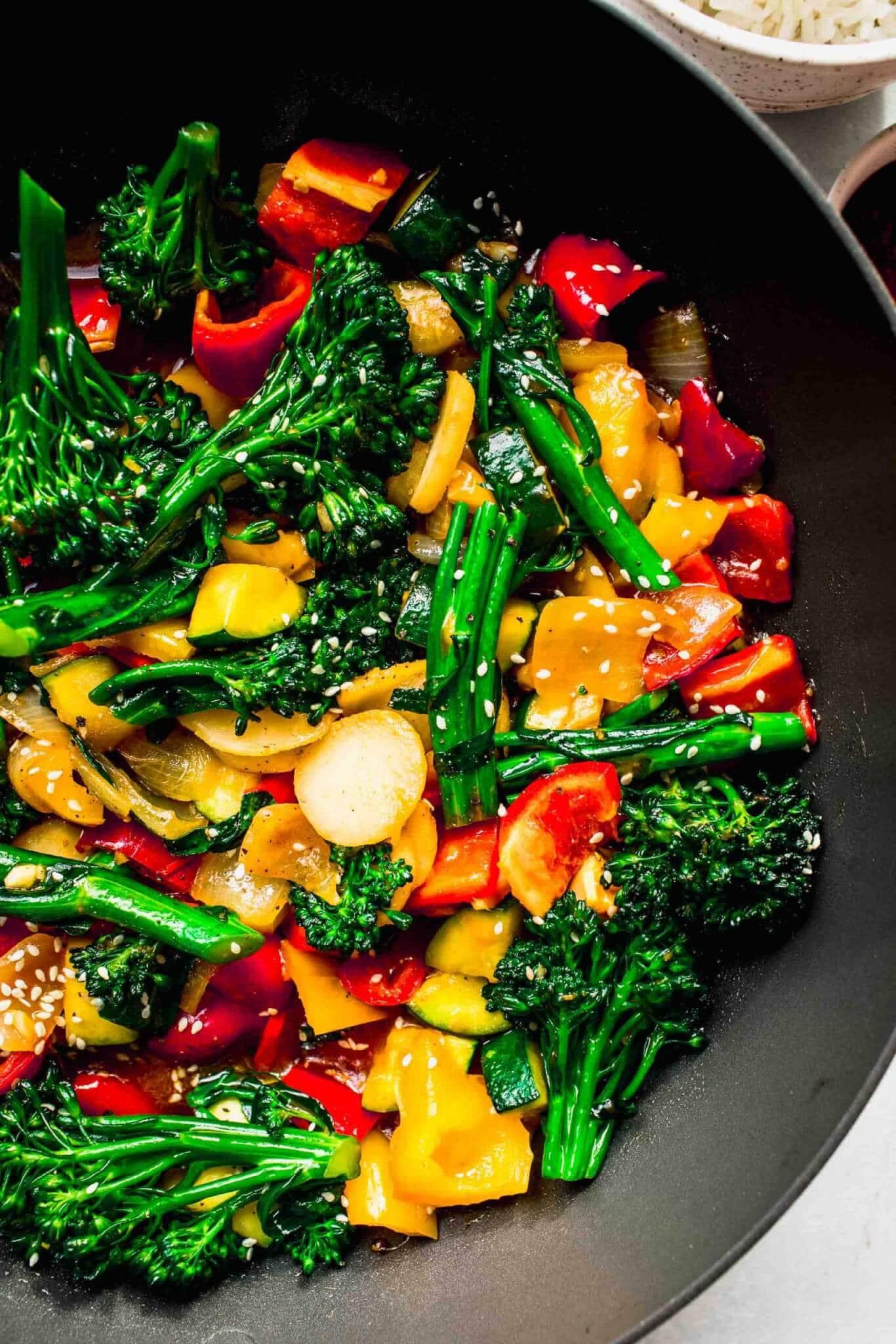 Close up of veggie stir fry in wok.
