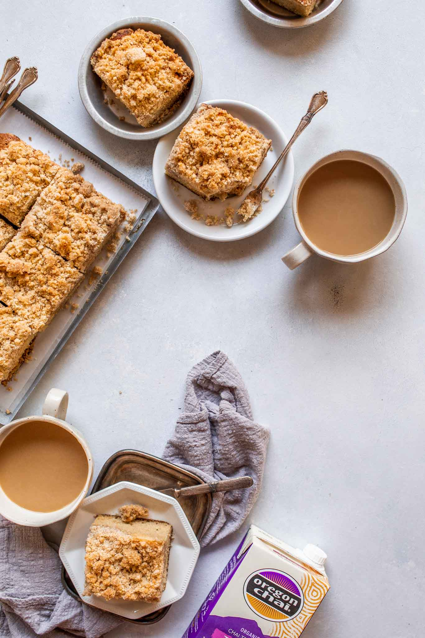Overhead shot of chai spiced crumb cake next to coffee.