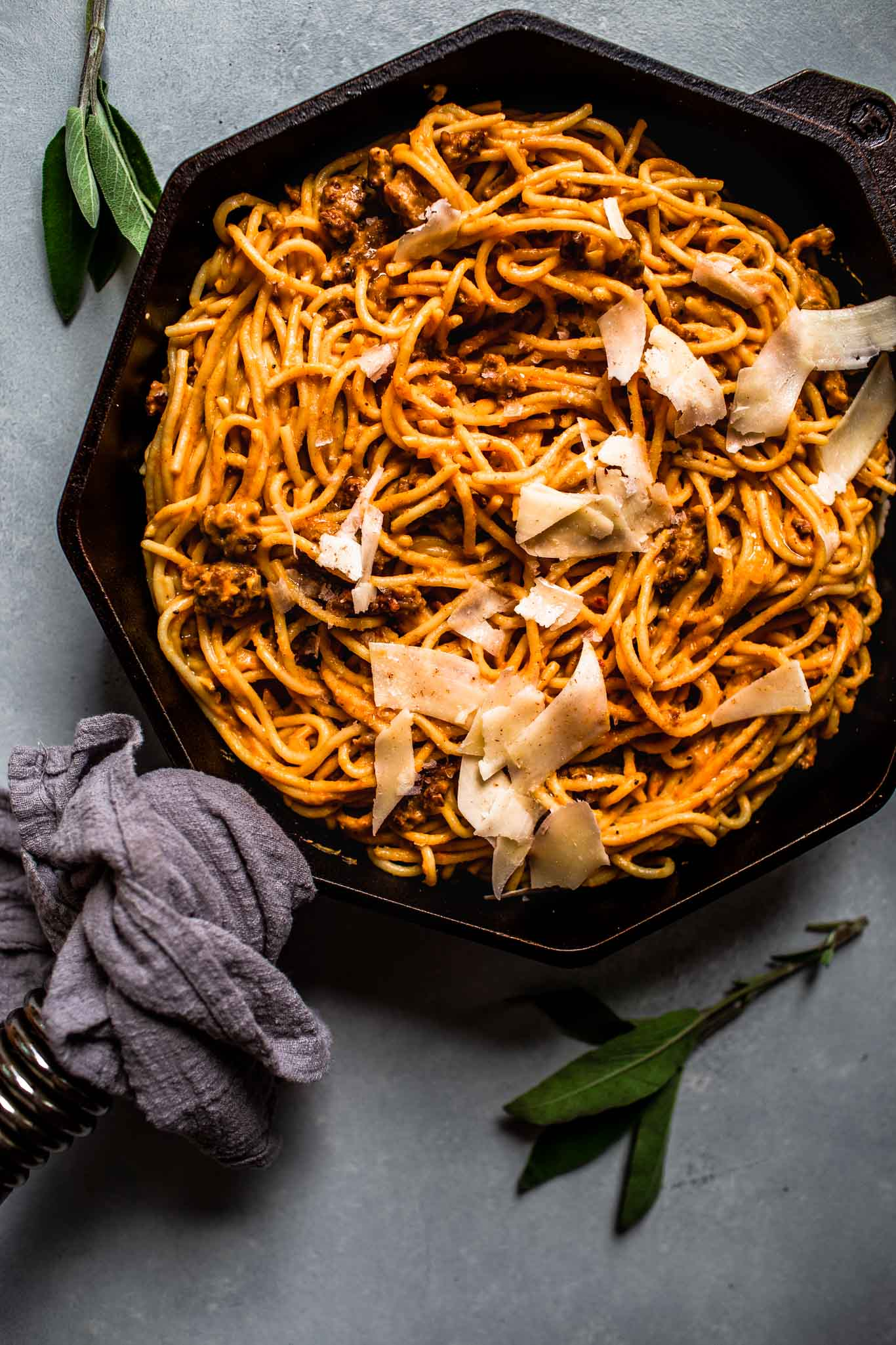 Pumpkin pasta in skillet.