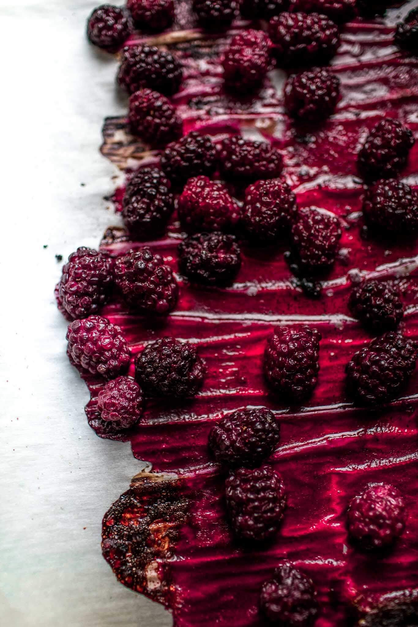 Roasted blackberries on baking sheet.