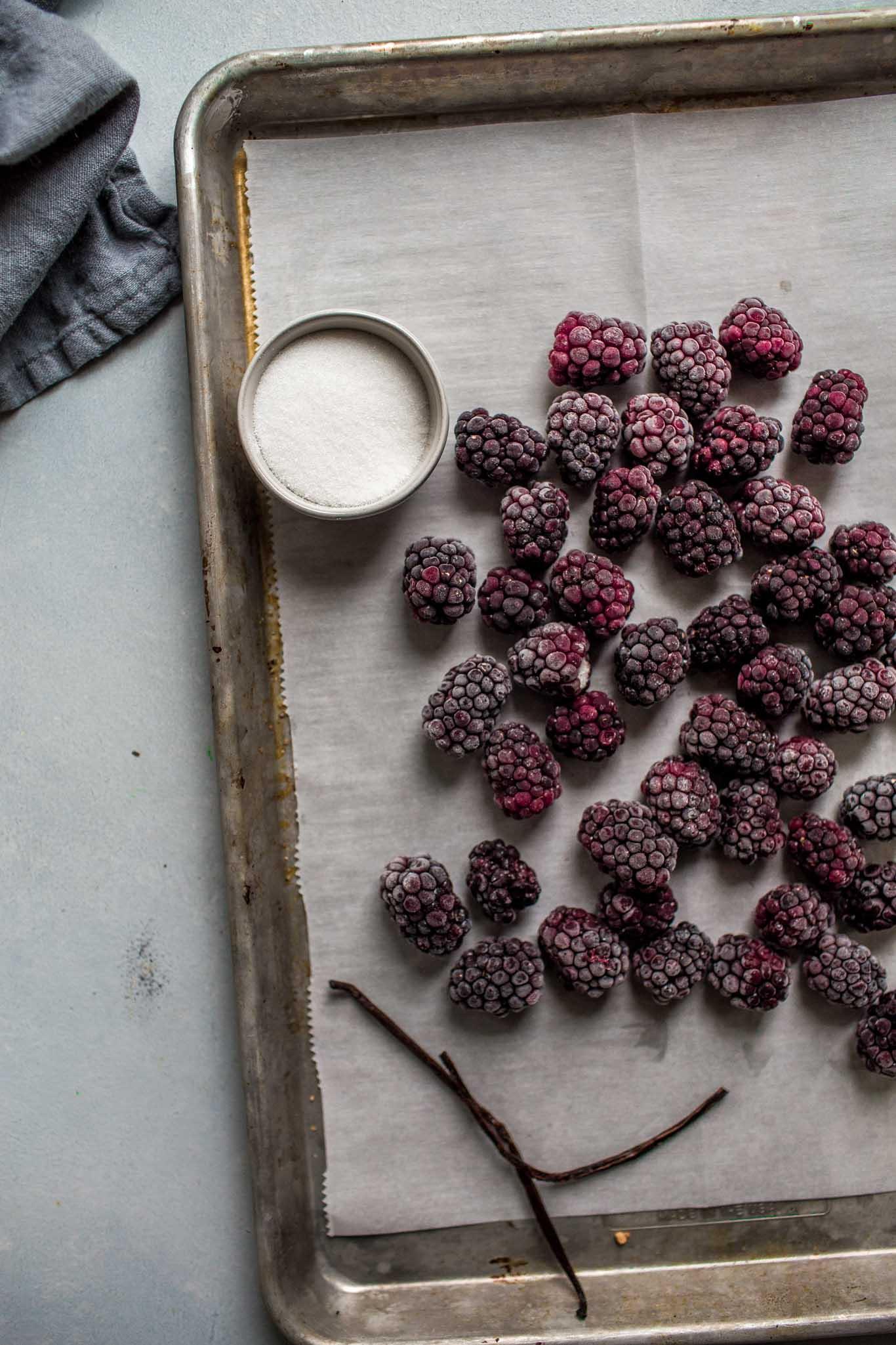 Frozen berries on baking sheet.