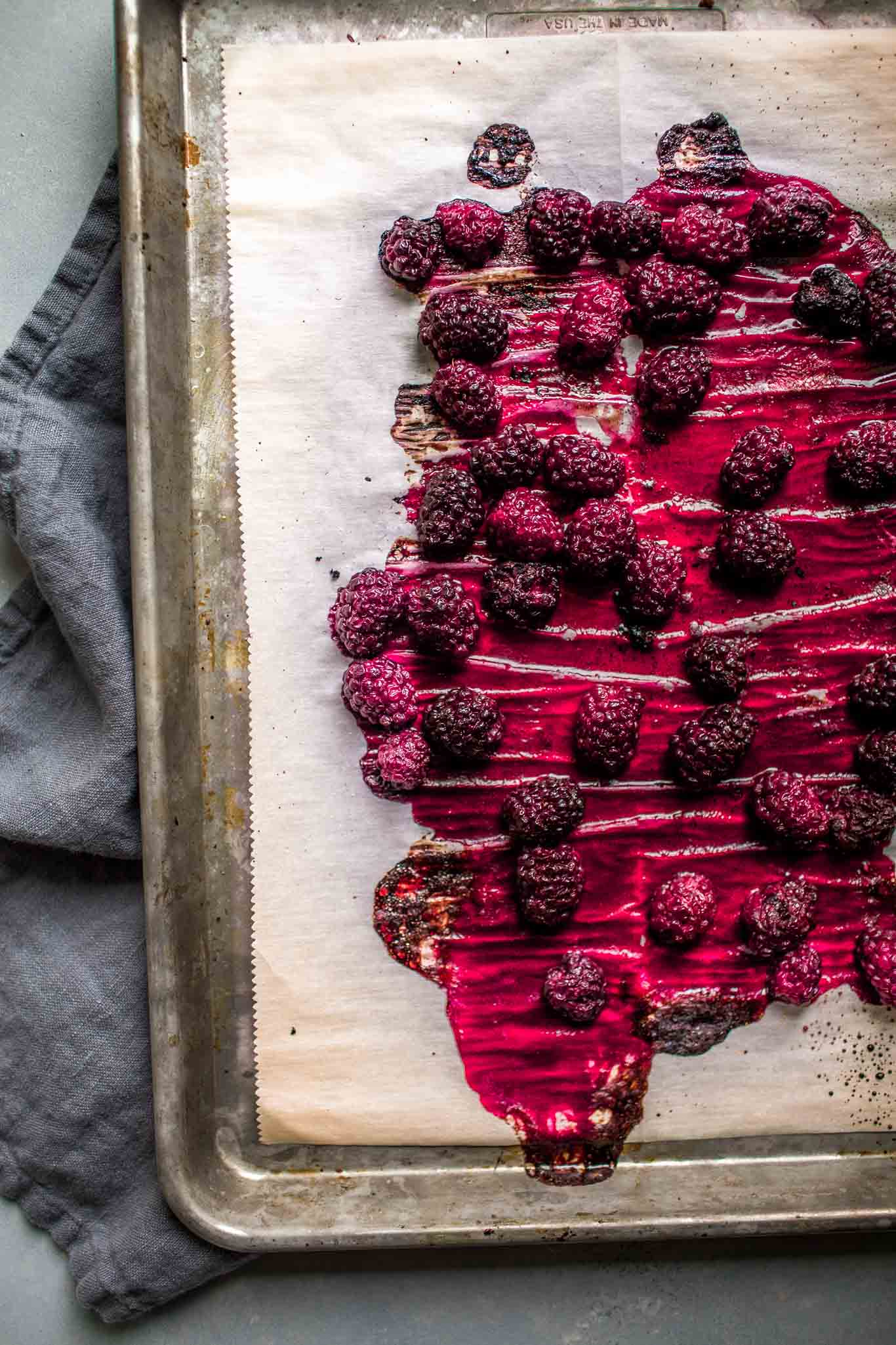 Roasted blackberries on baking sheet.