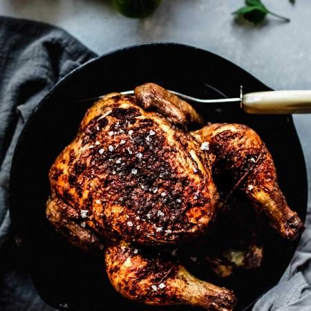 Overhead shot of chicken in cast iron skillet.
