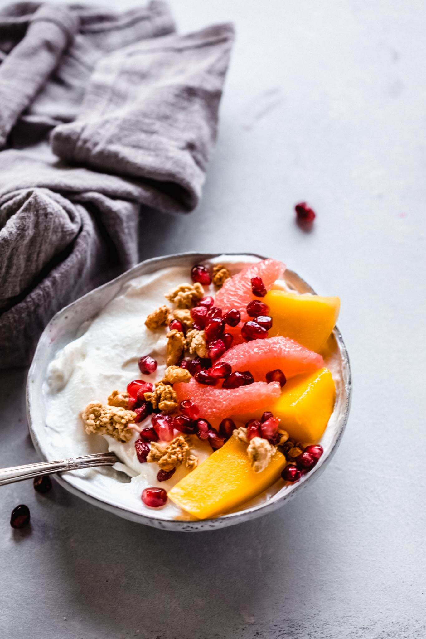 Yogurt topped with mango, grapefruit, granola & pomegranate.
