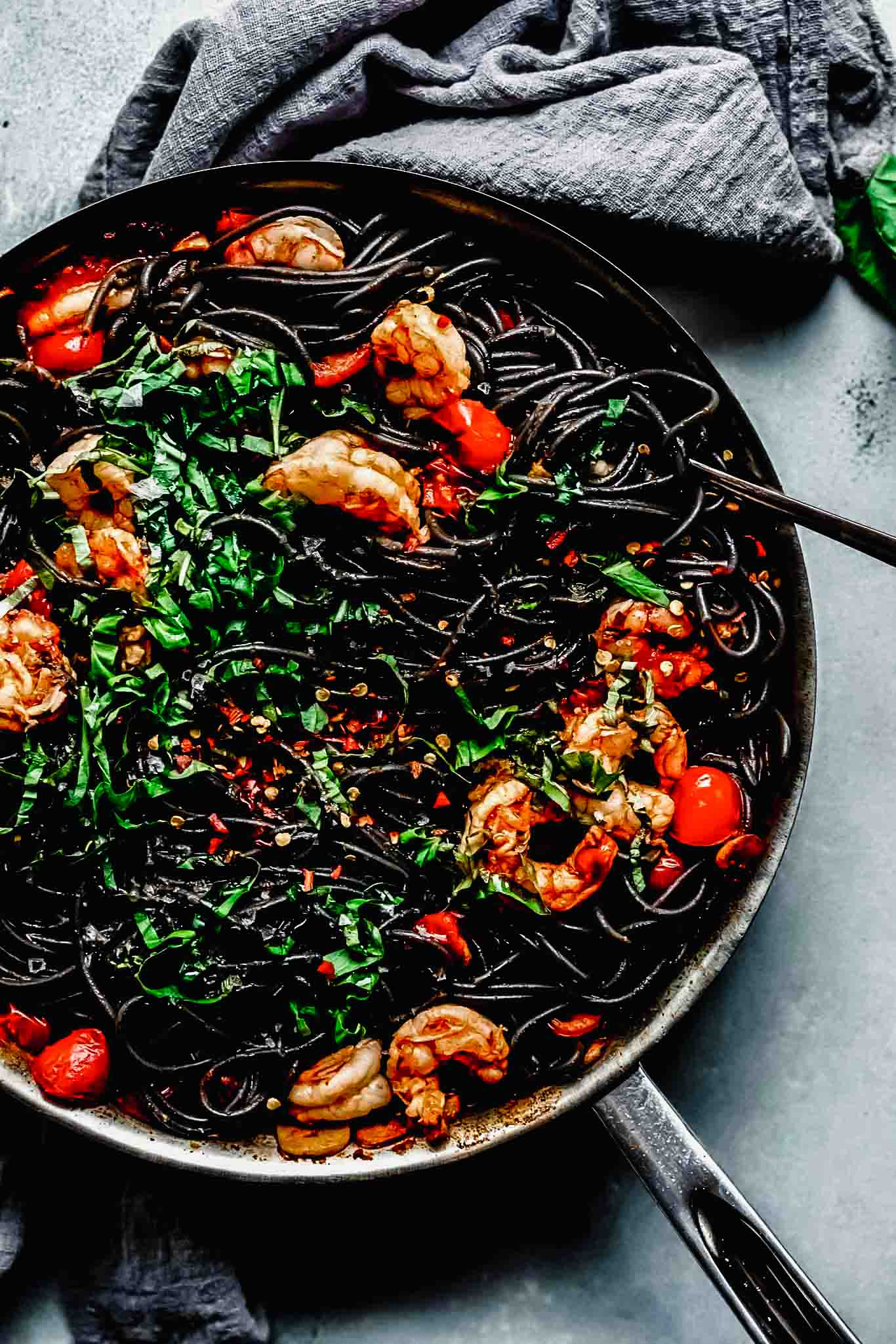 Squid ink pasta in skillet.