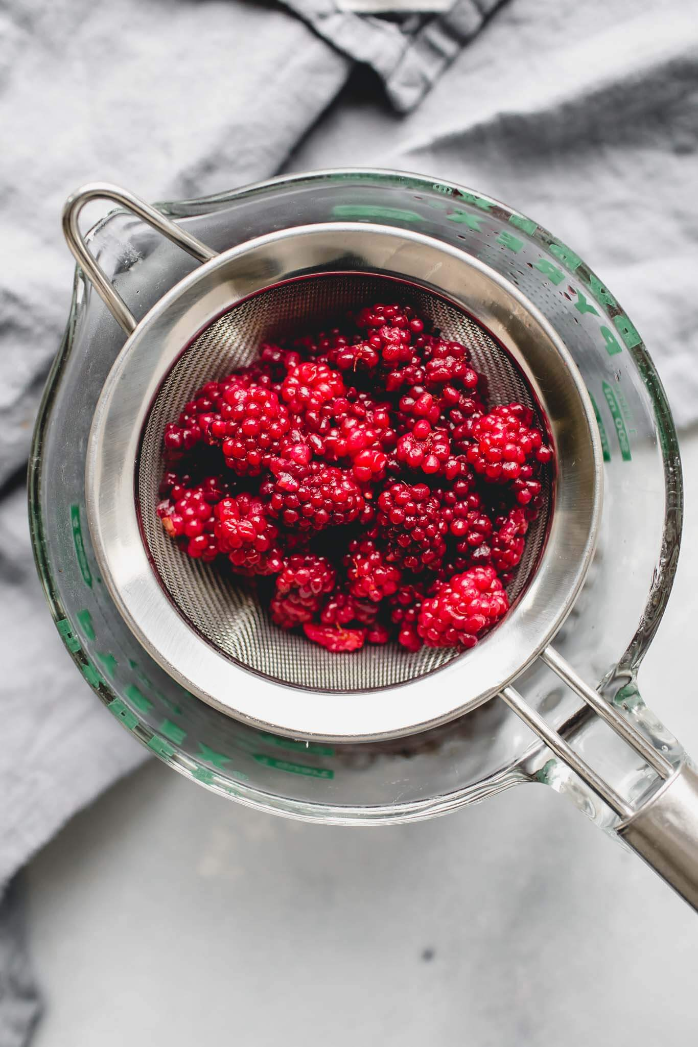 Blackberries in strainer.
