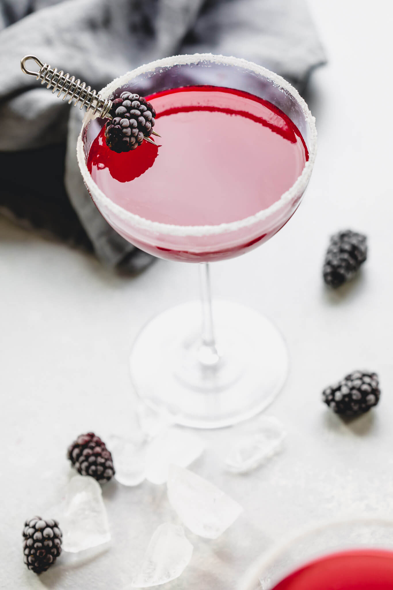 Two blackberry lemon drop cocktails.