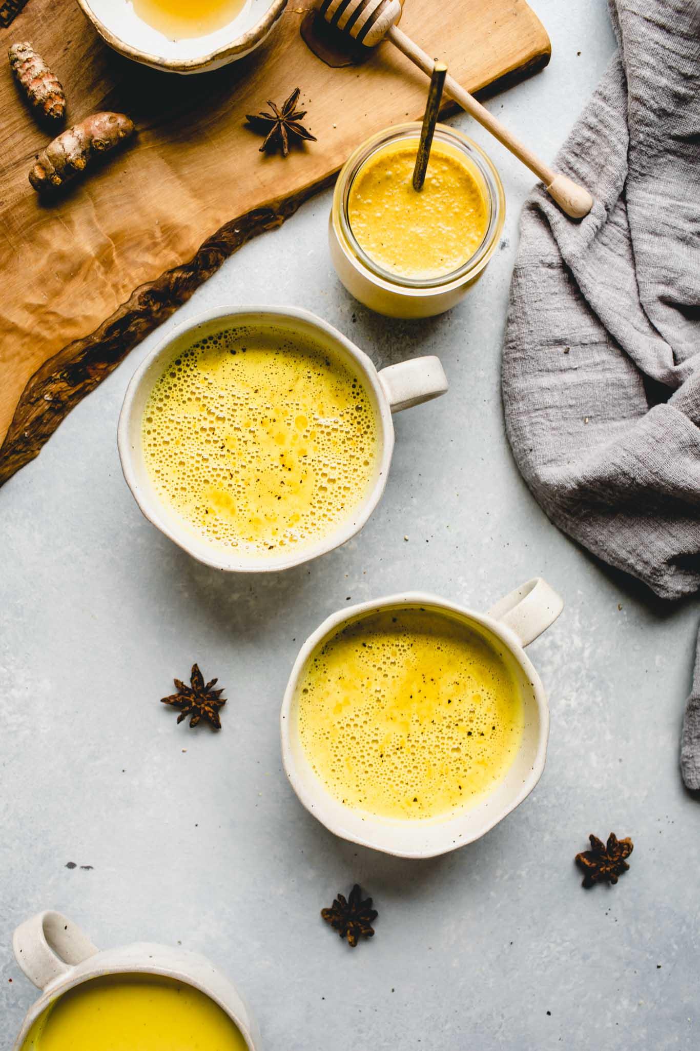 Three cups of golden milk latte.