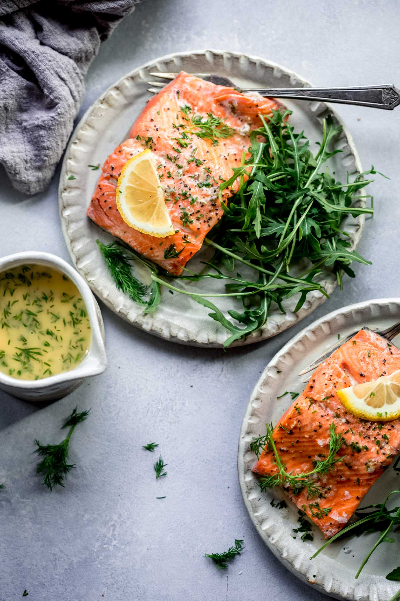 Two plates of salmon.