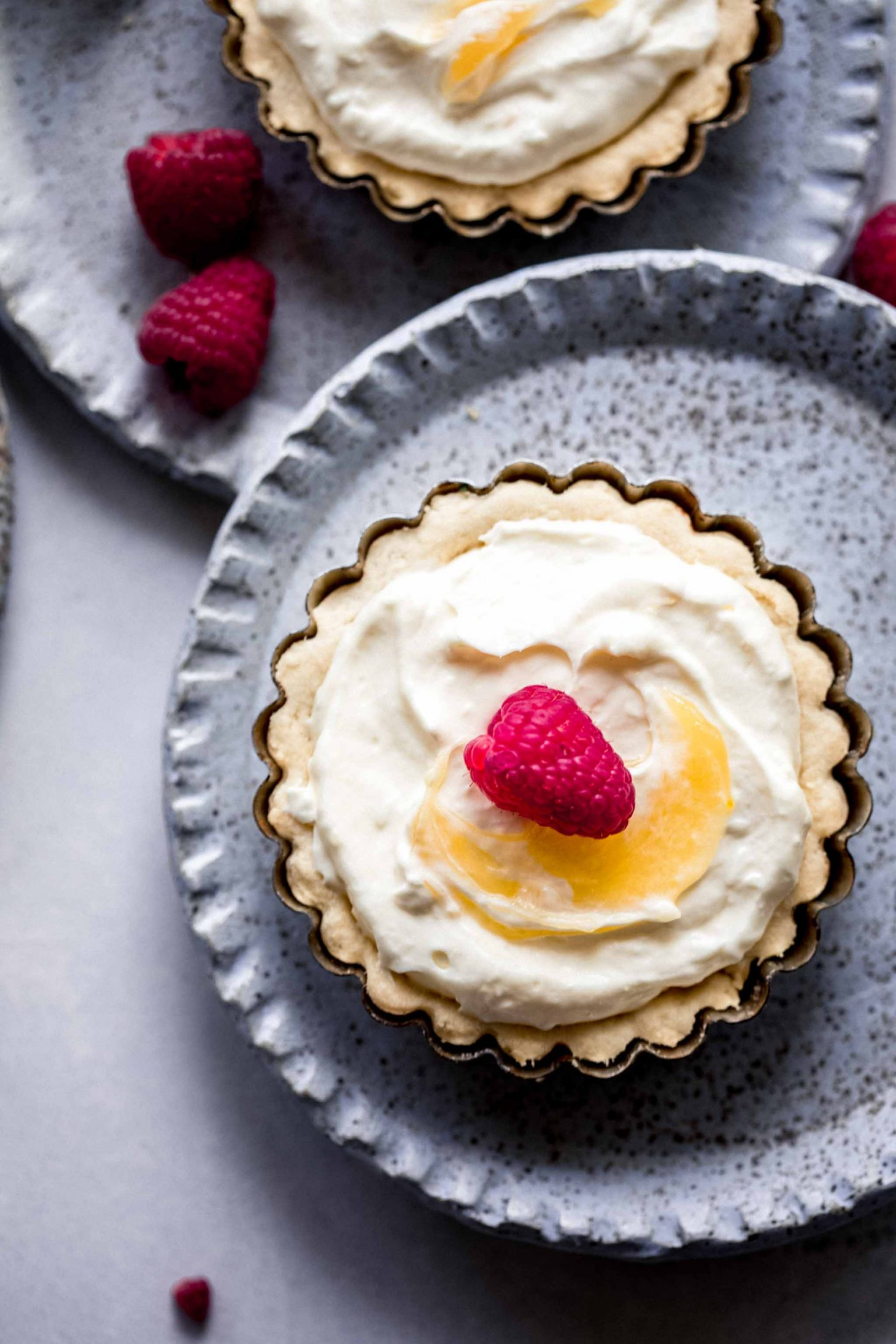 Overhead close up of Lemon Tartlet topped with raspberry.