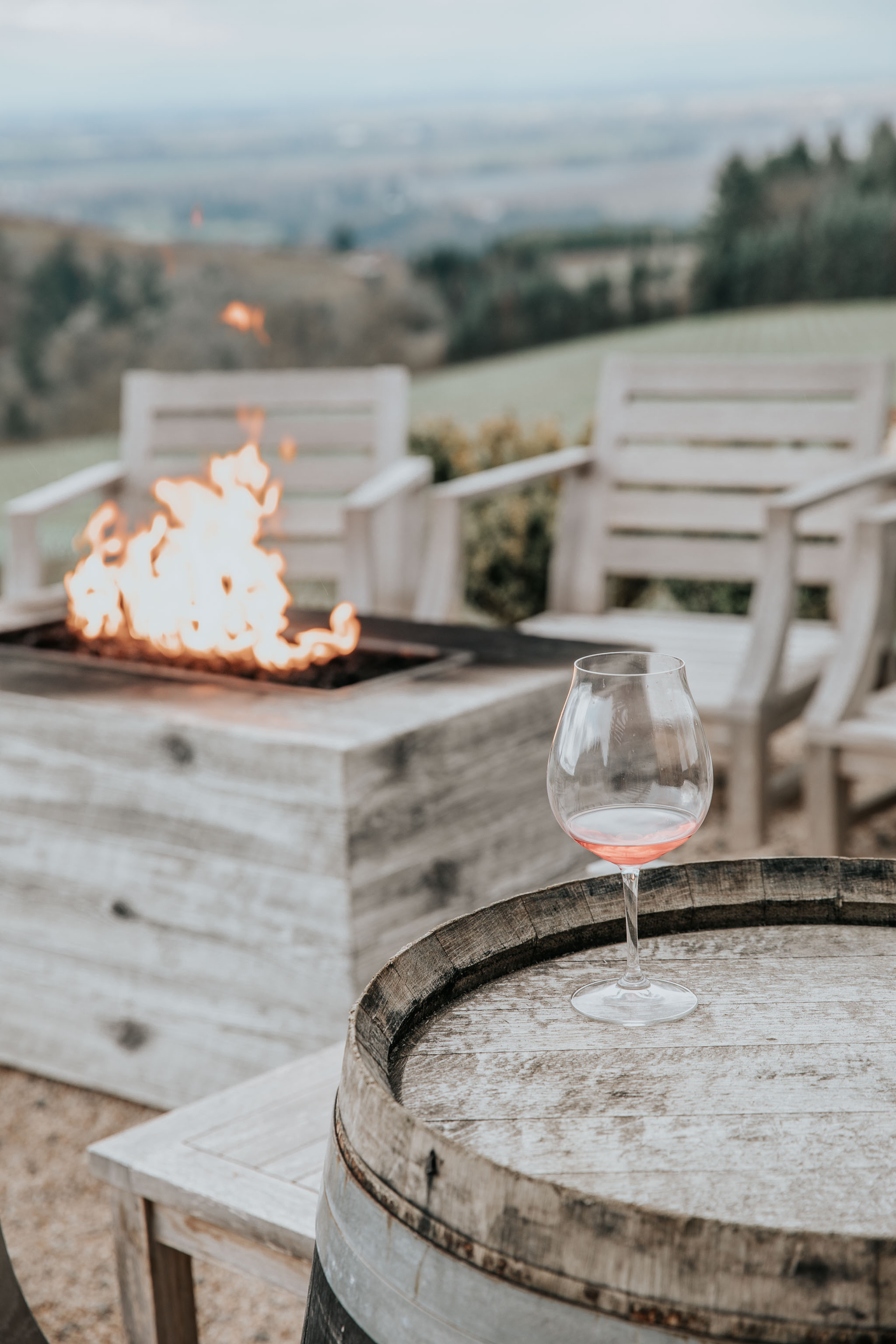 Glass of rose by fire pit at Black Walnut Inn
