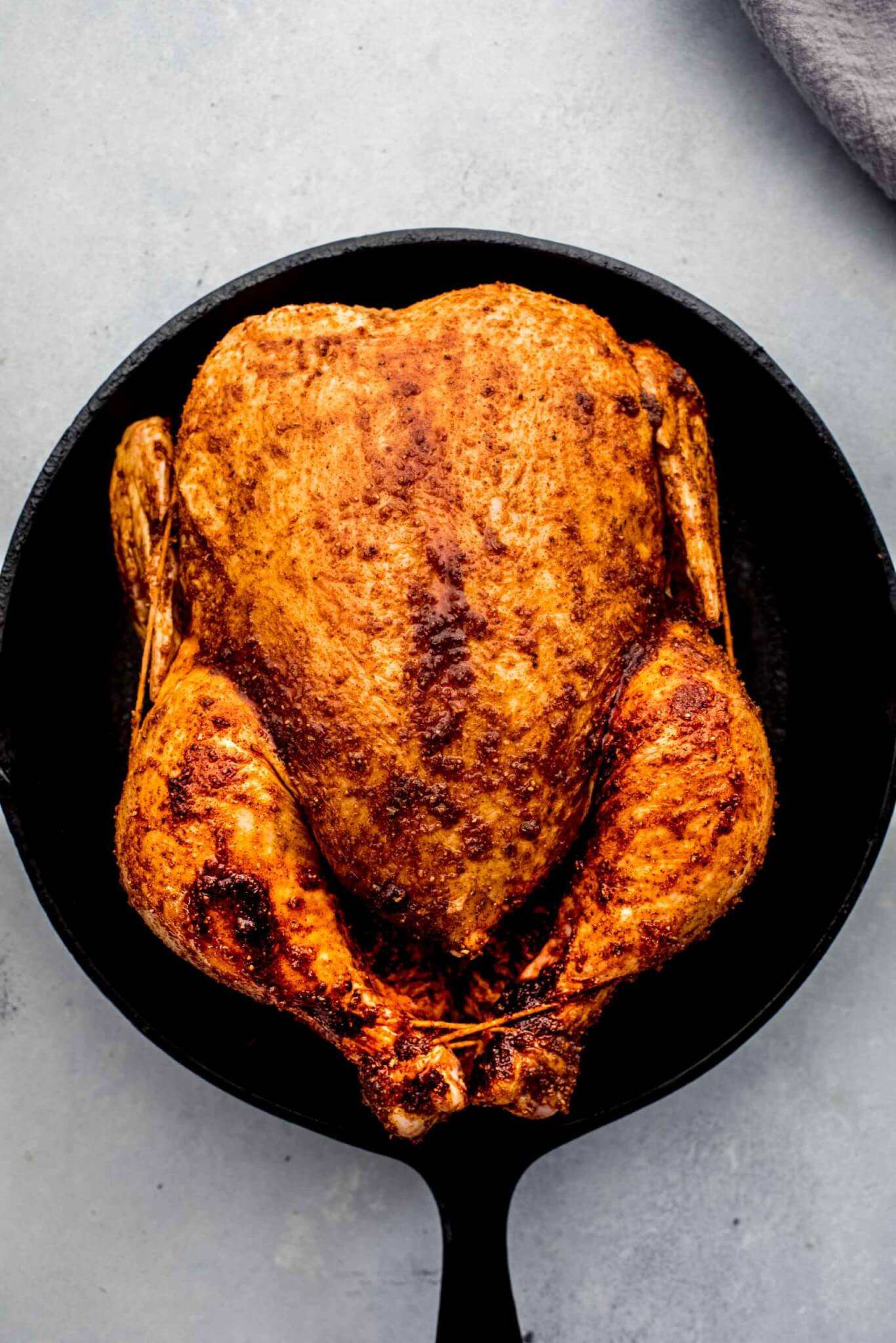 Chicken in cast iron skillet before baking.