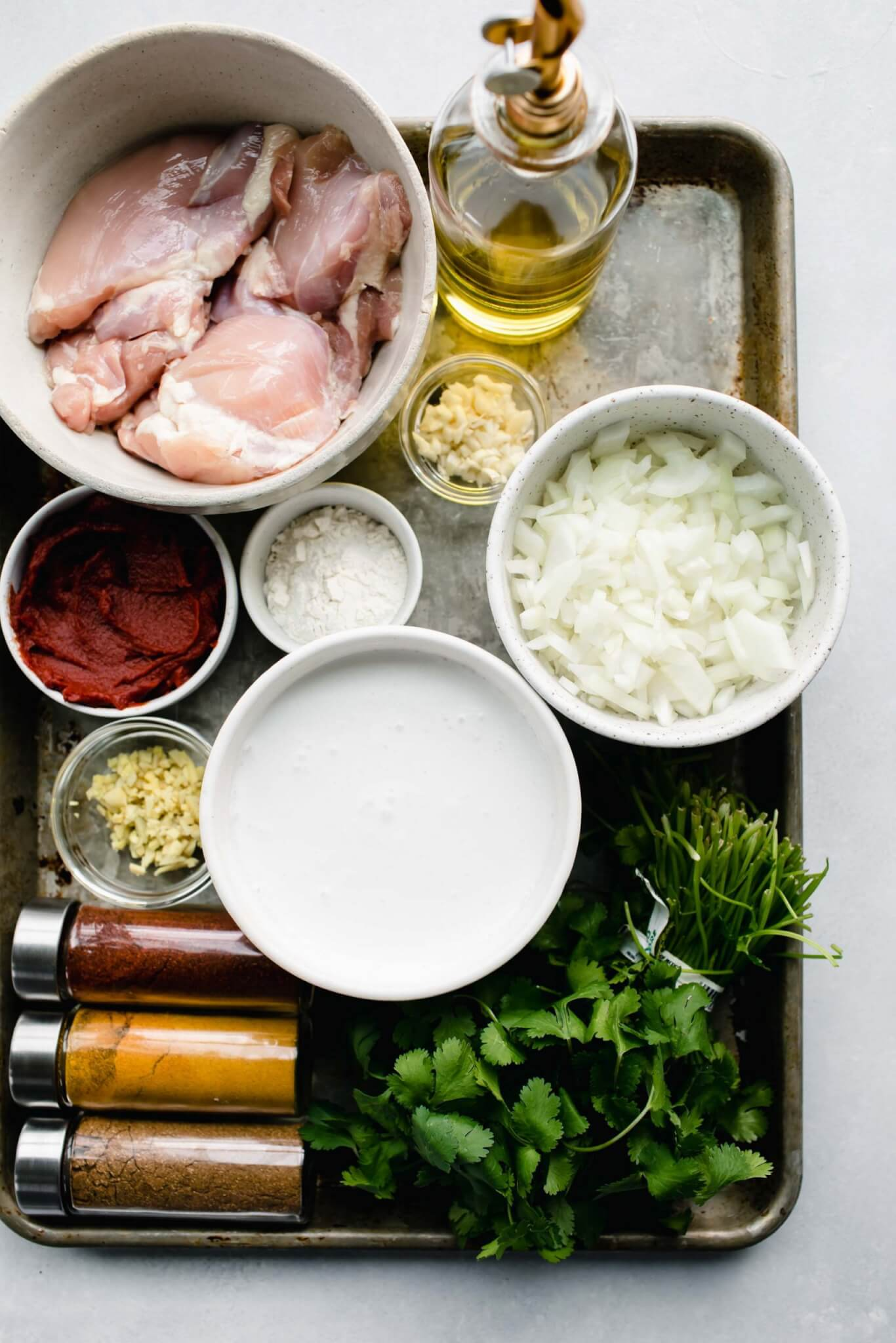 Ingredients for instant pot butter chicken laid on tray.