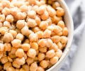 Side view close up of bowl of cooked instant pot chickpeas.