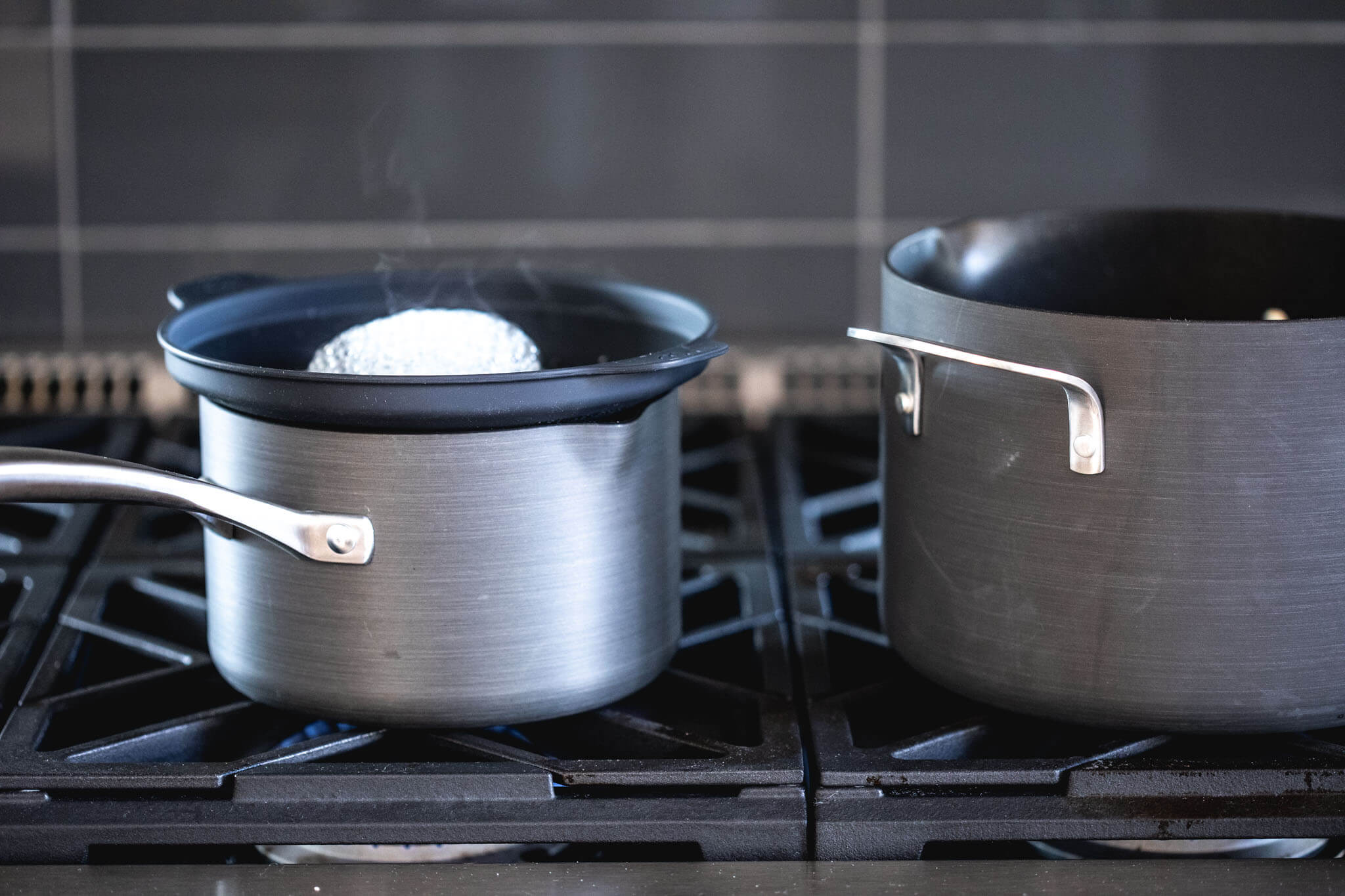 Two calphalon pots on gas stove