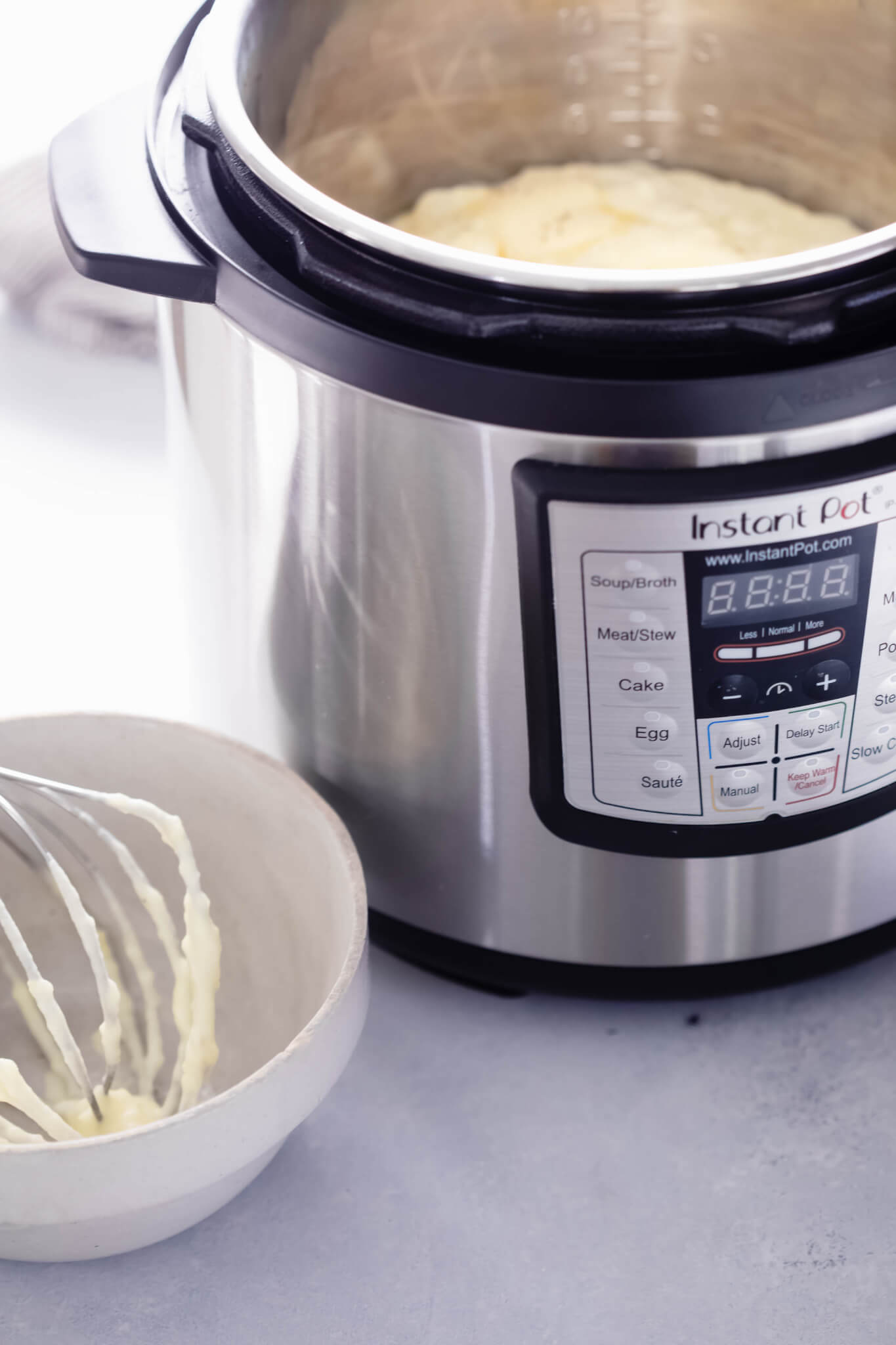 Side view of instant pot filled with mashed potatoes.