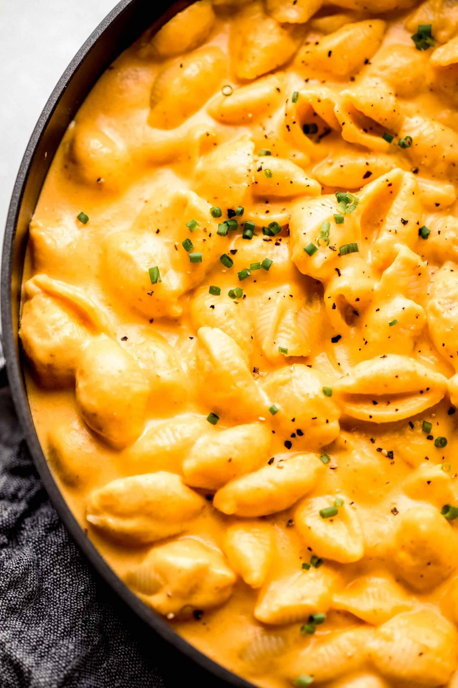 Overhead close up of pumpkin mac & cheese in skillet.