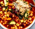 Overhead close up of bowl of minestrone soup.
