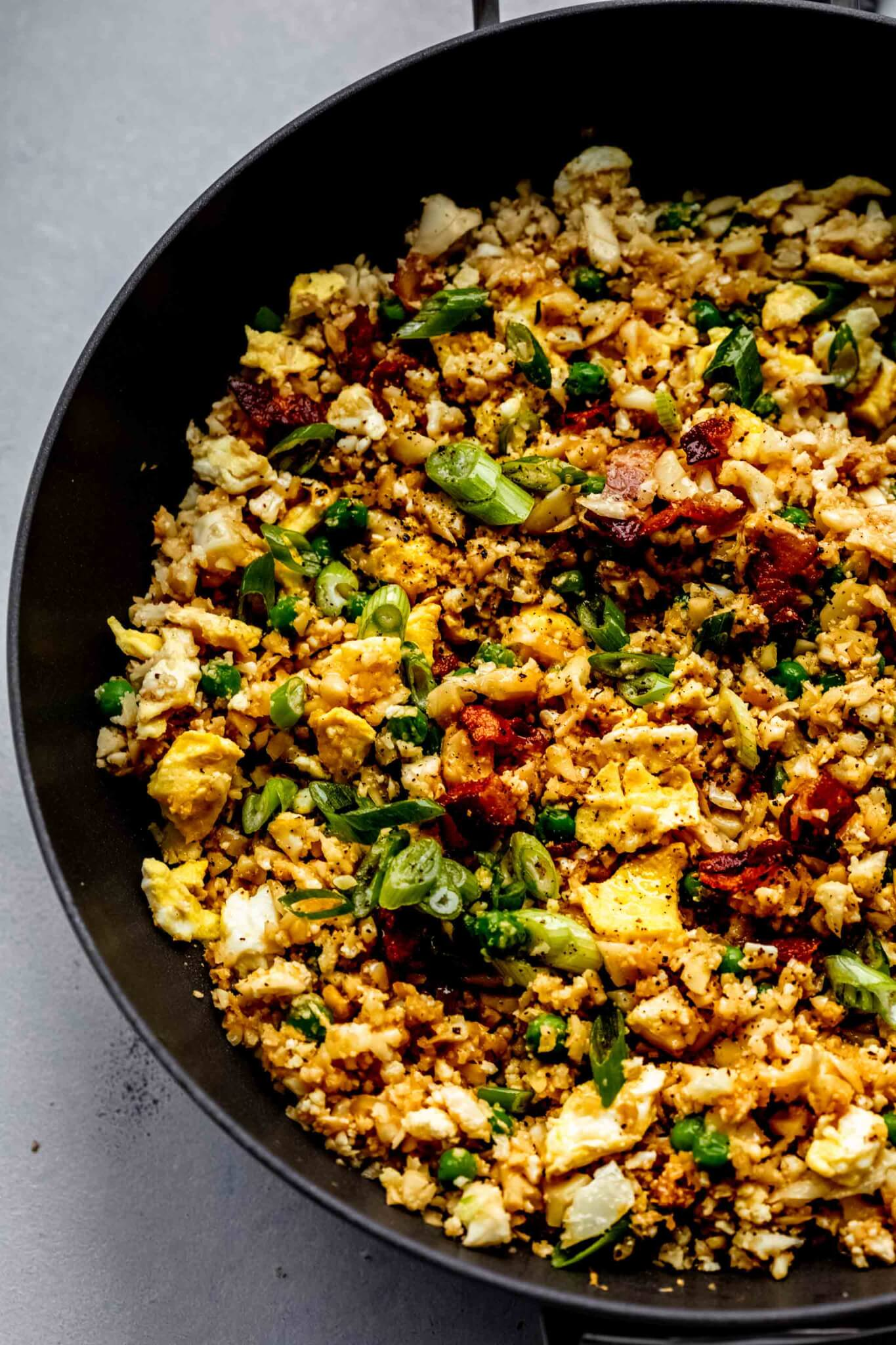 Cauliflower fried rice in wok after cooking.