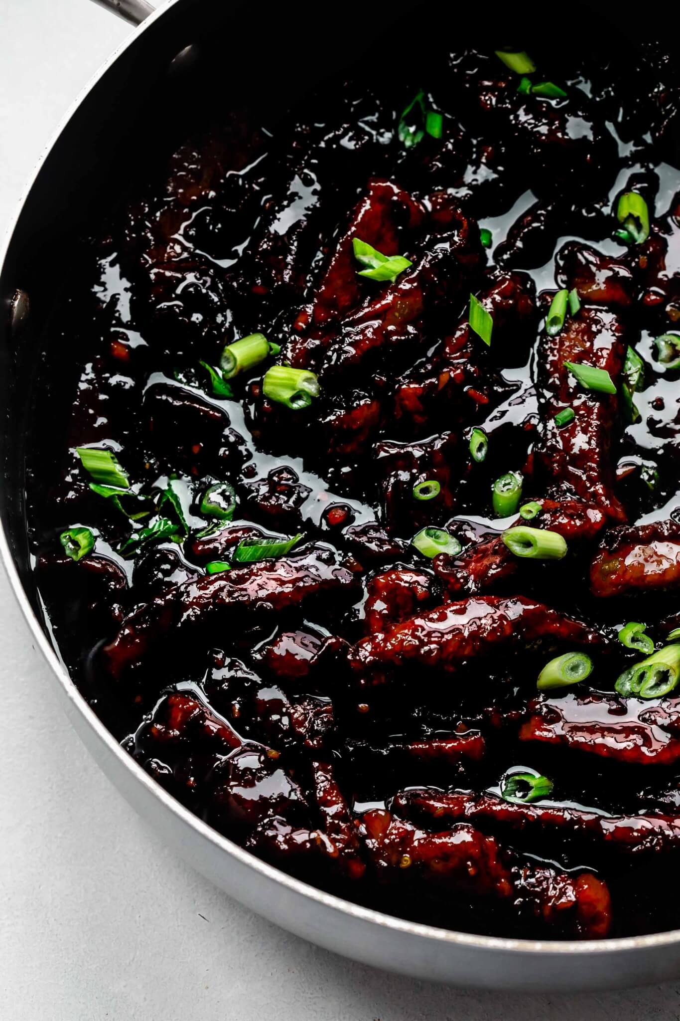 Cooked mongolian beef in large skillet.