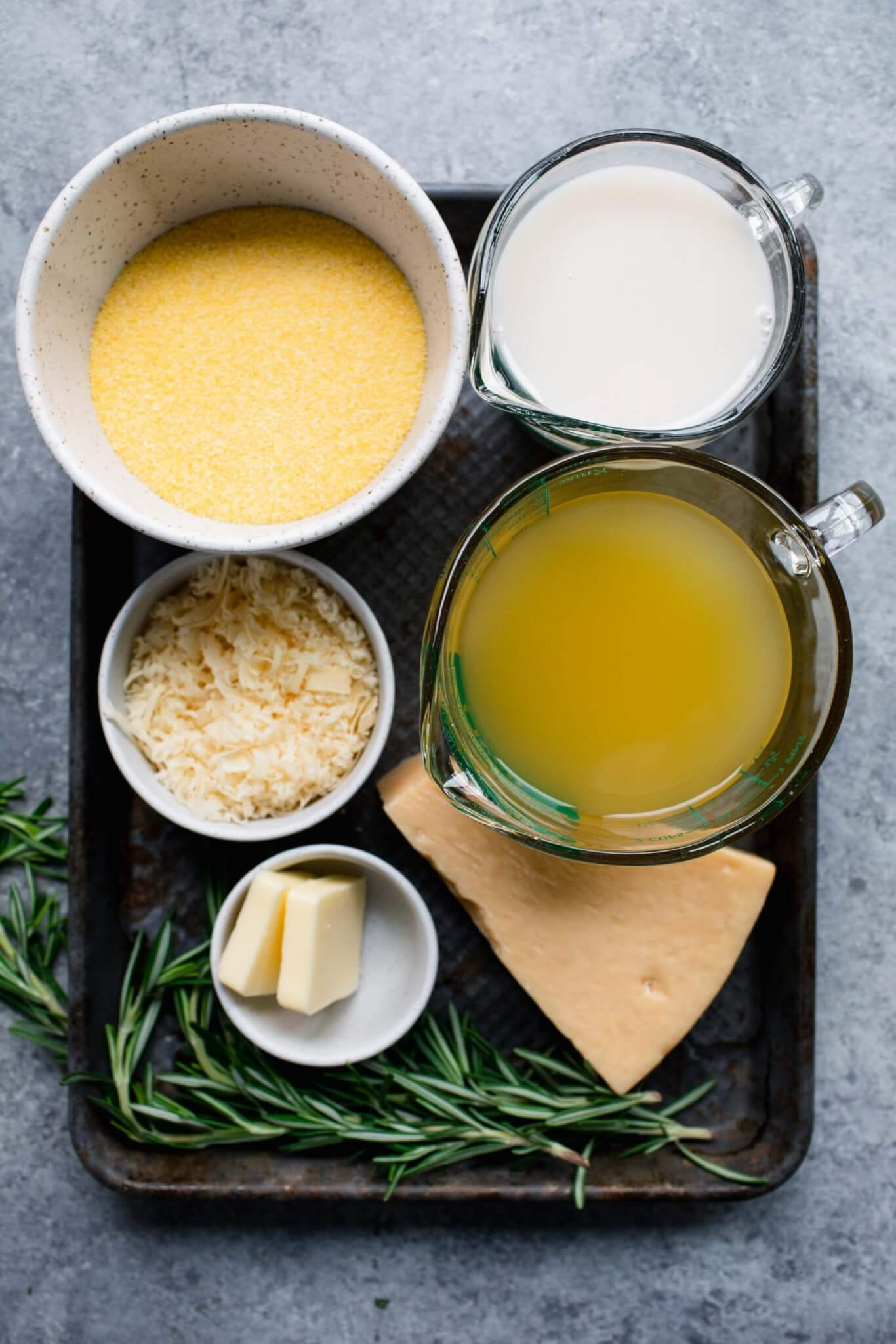 Ingredients for creamy polenta laid out on tray.