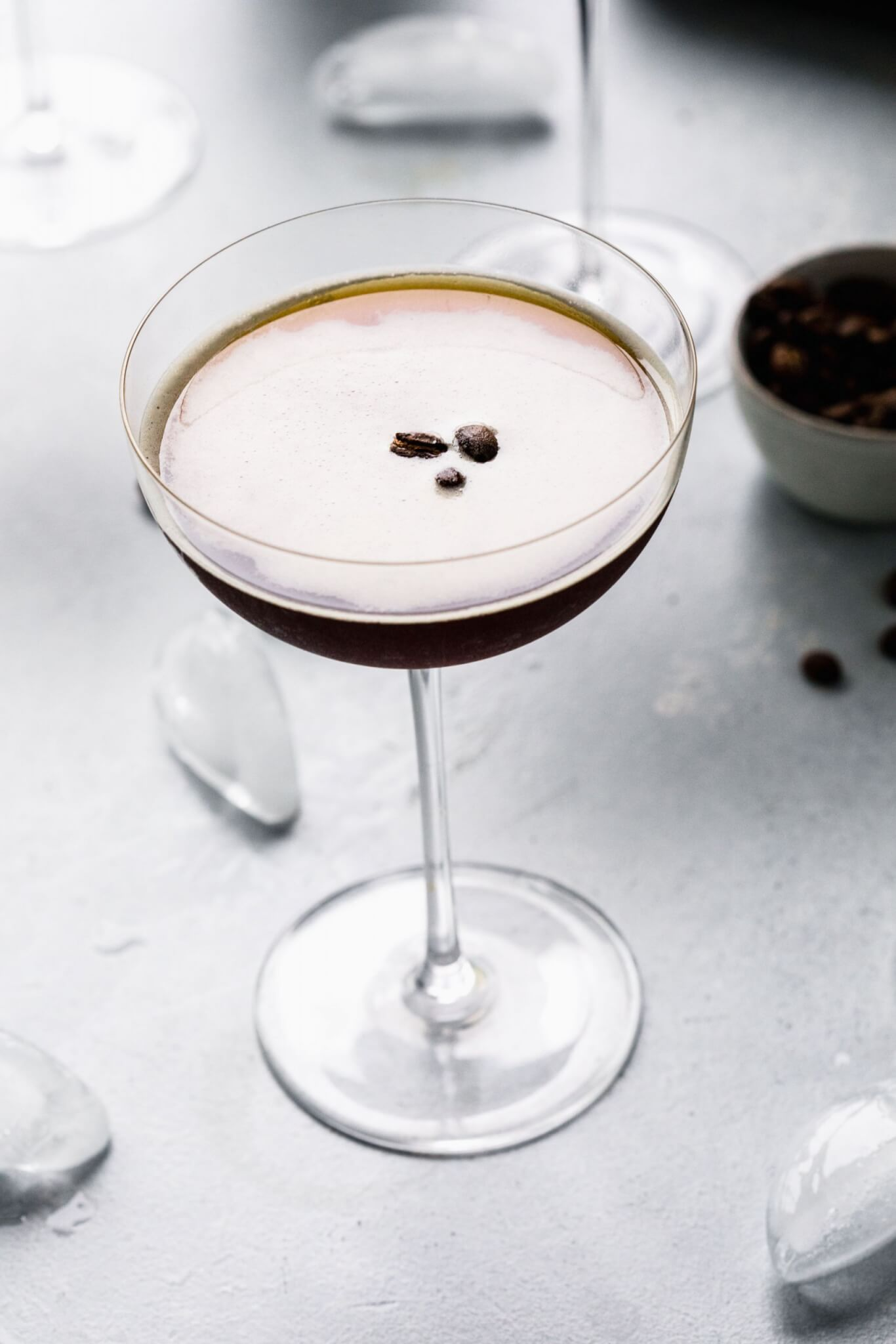 Single espresso martini prepared with good froth on top.